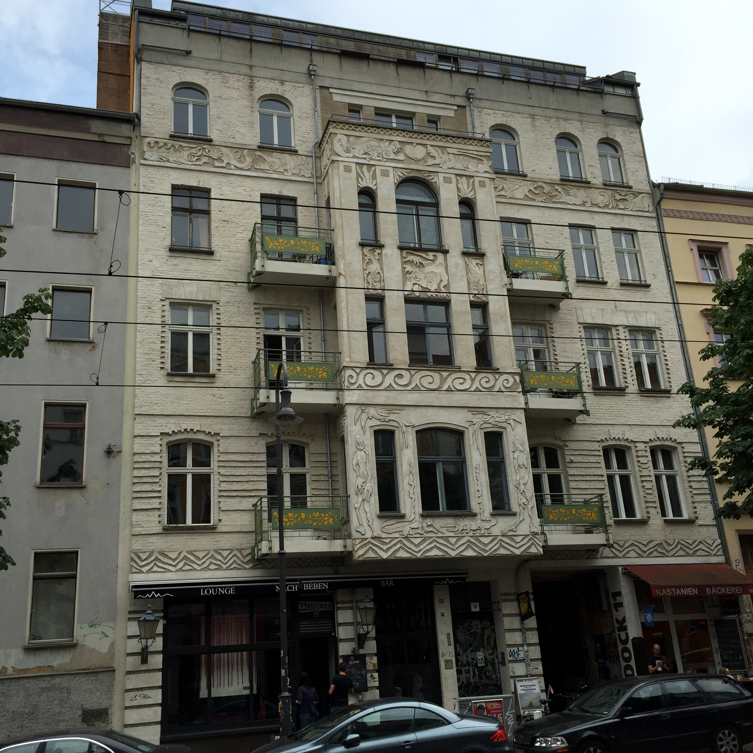 19th century apartment building flanked by more recent infill on Kastanienallee, Prenzlauer Berg. Throughout East Berlin these elevations speak of Vienna and Lodz and Budapest all rolled into one.