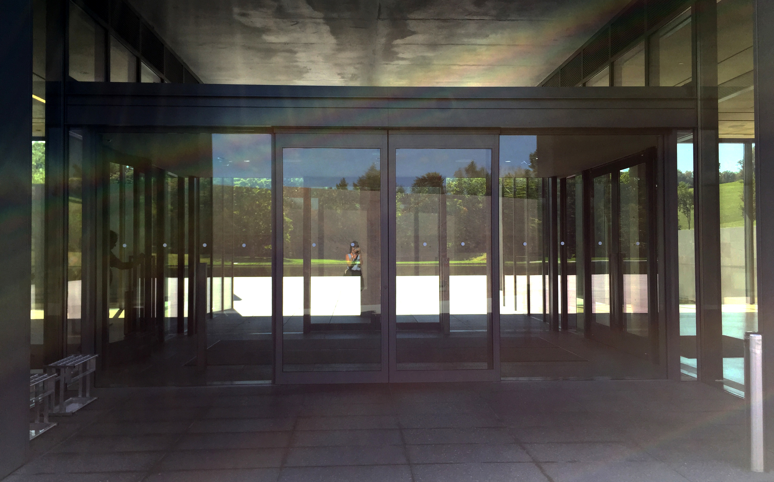 Entrance doors give views to the landscape beyond