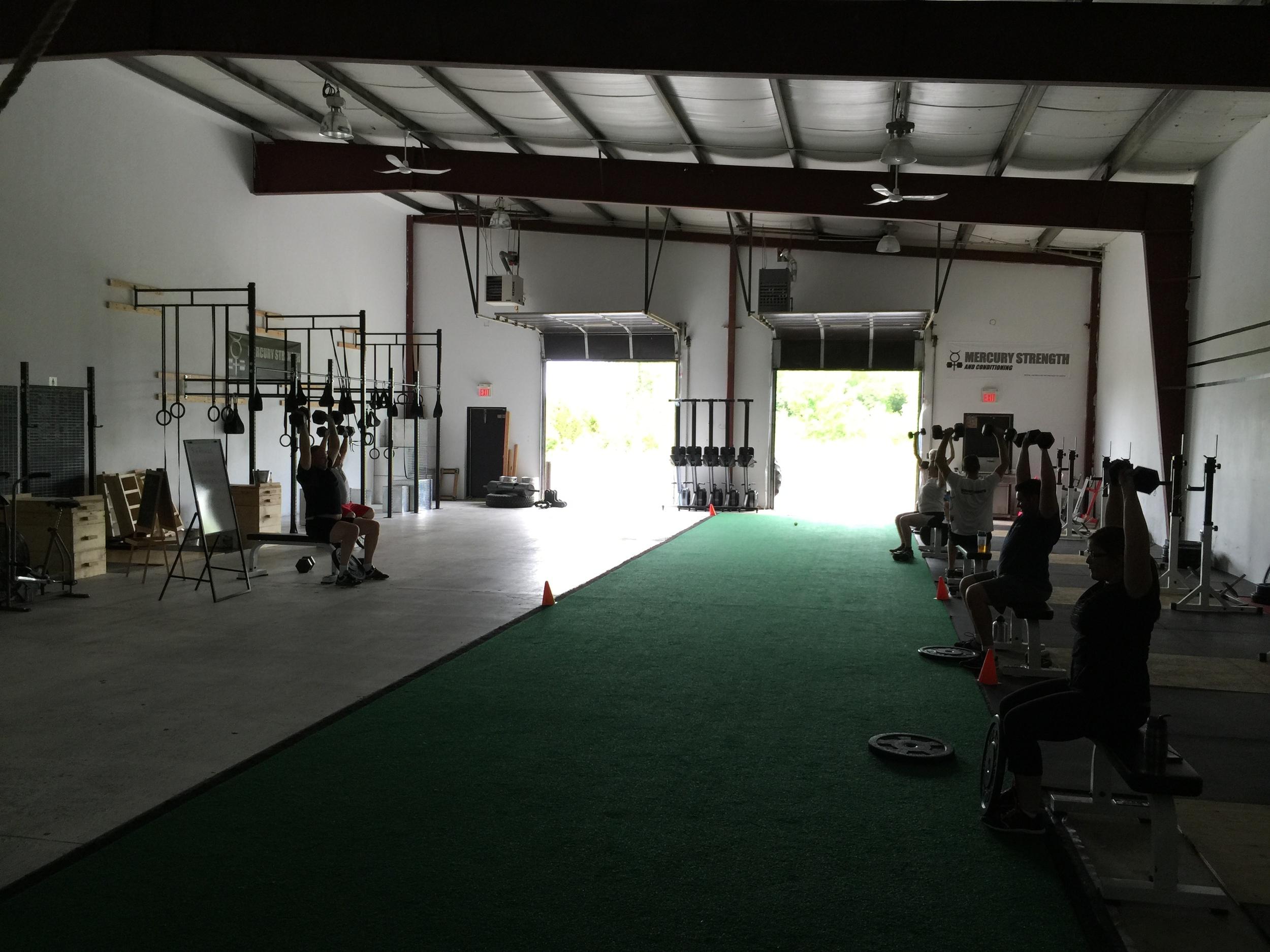 gym-fitness-training-kingston-seated DB press