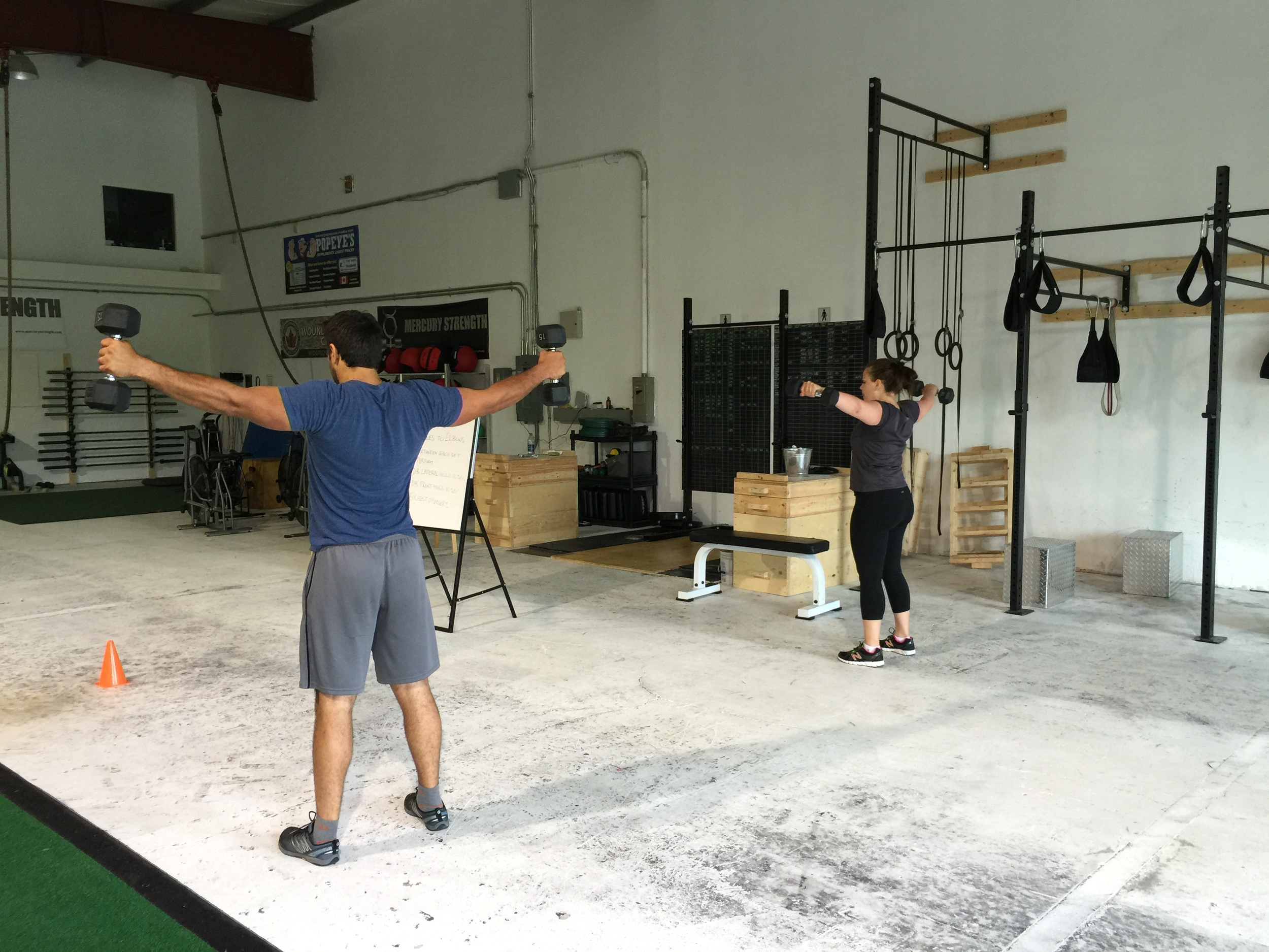 Mike and Michelle performing the lateral DB hold this morning.