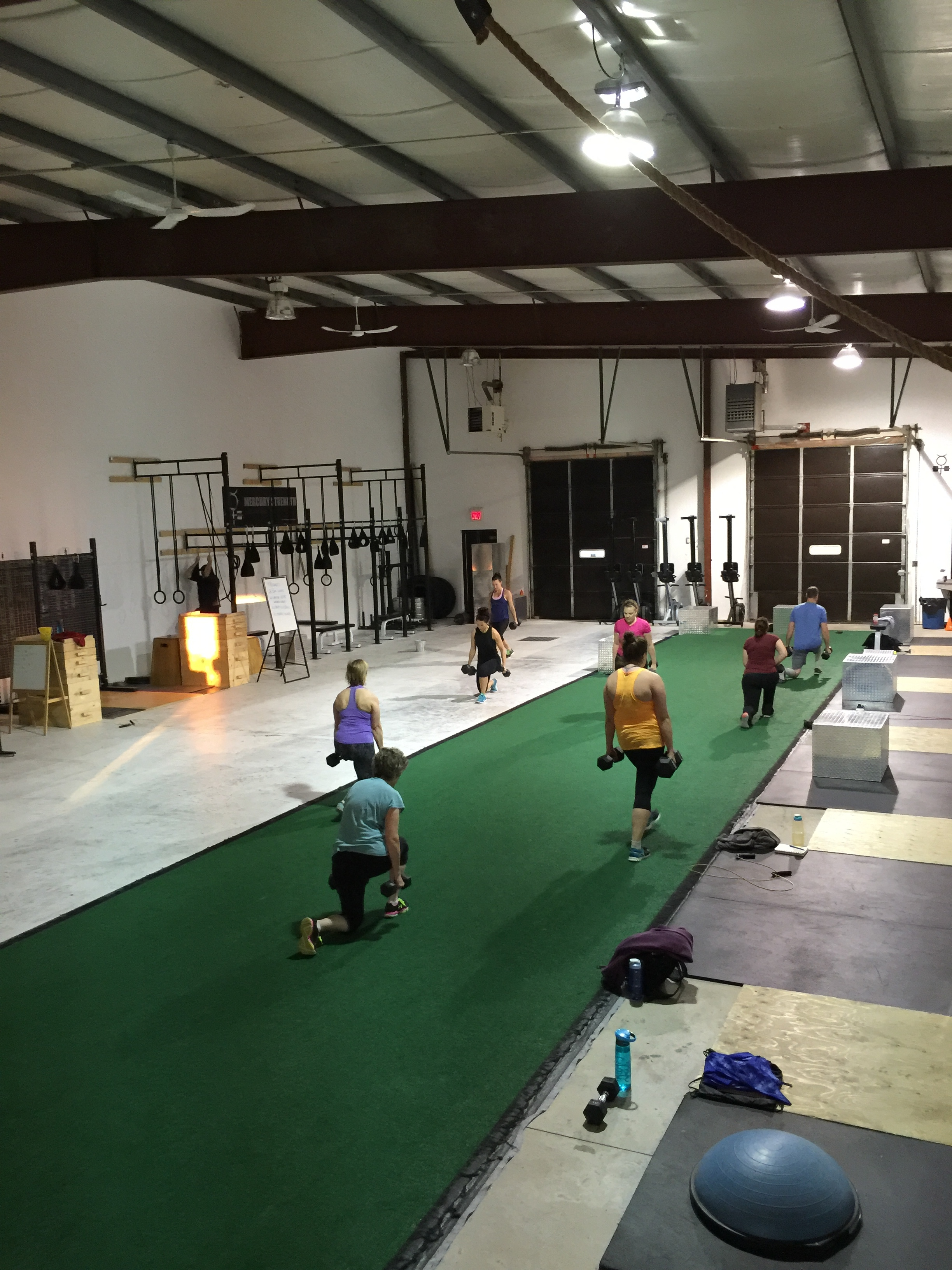 Uneven walking lunges being performed. Such a great exercise. Focuses on grip strength, balance, trunk stabilization, glute and quad development, and mental toughness.