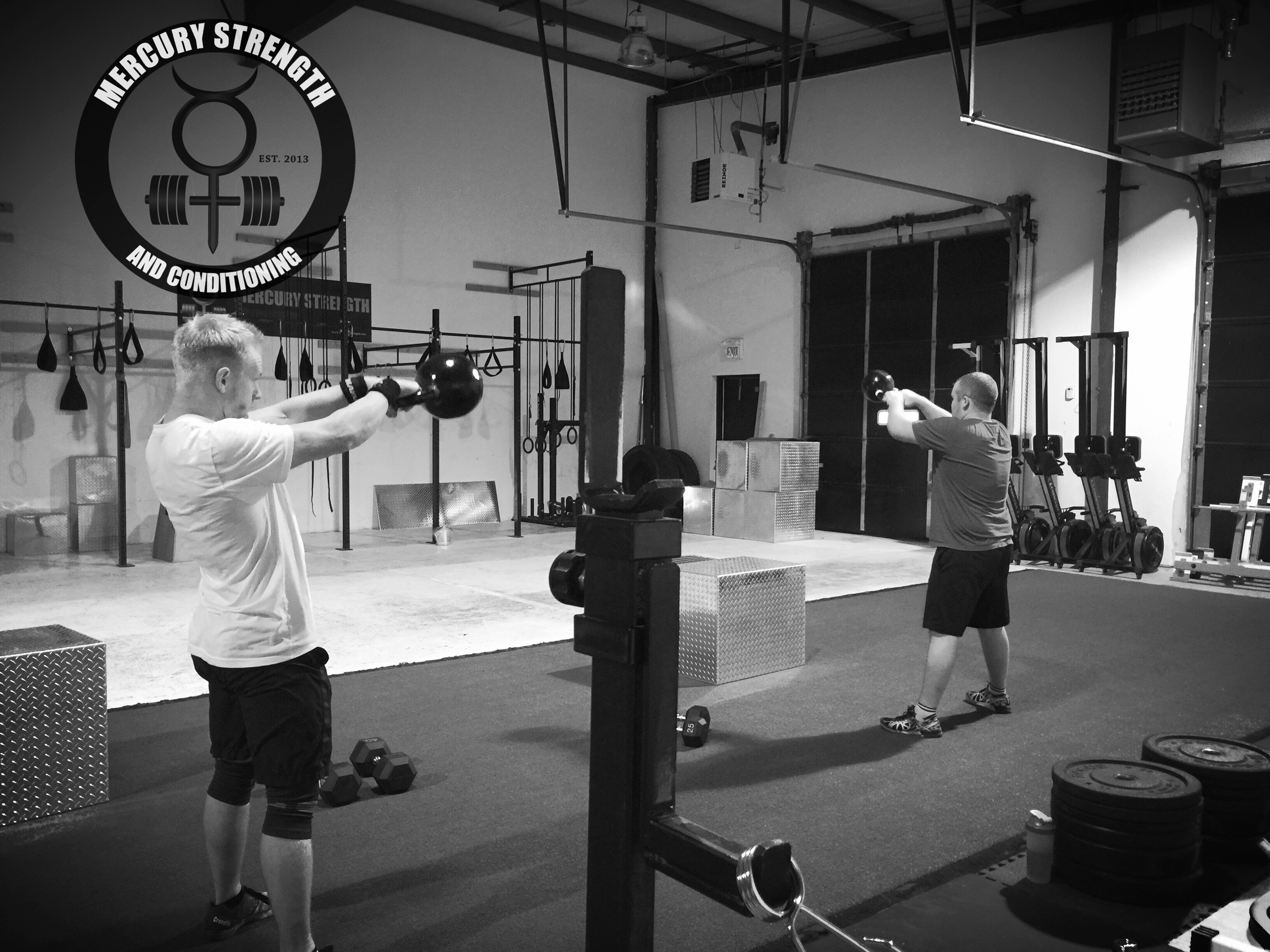 Alec Rhodes of Mercury Strength and Conditioning and Jay Rhodes, owner of CrossFit Outlaw North, duking it out in yesterday's conditioning workout.