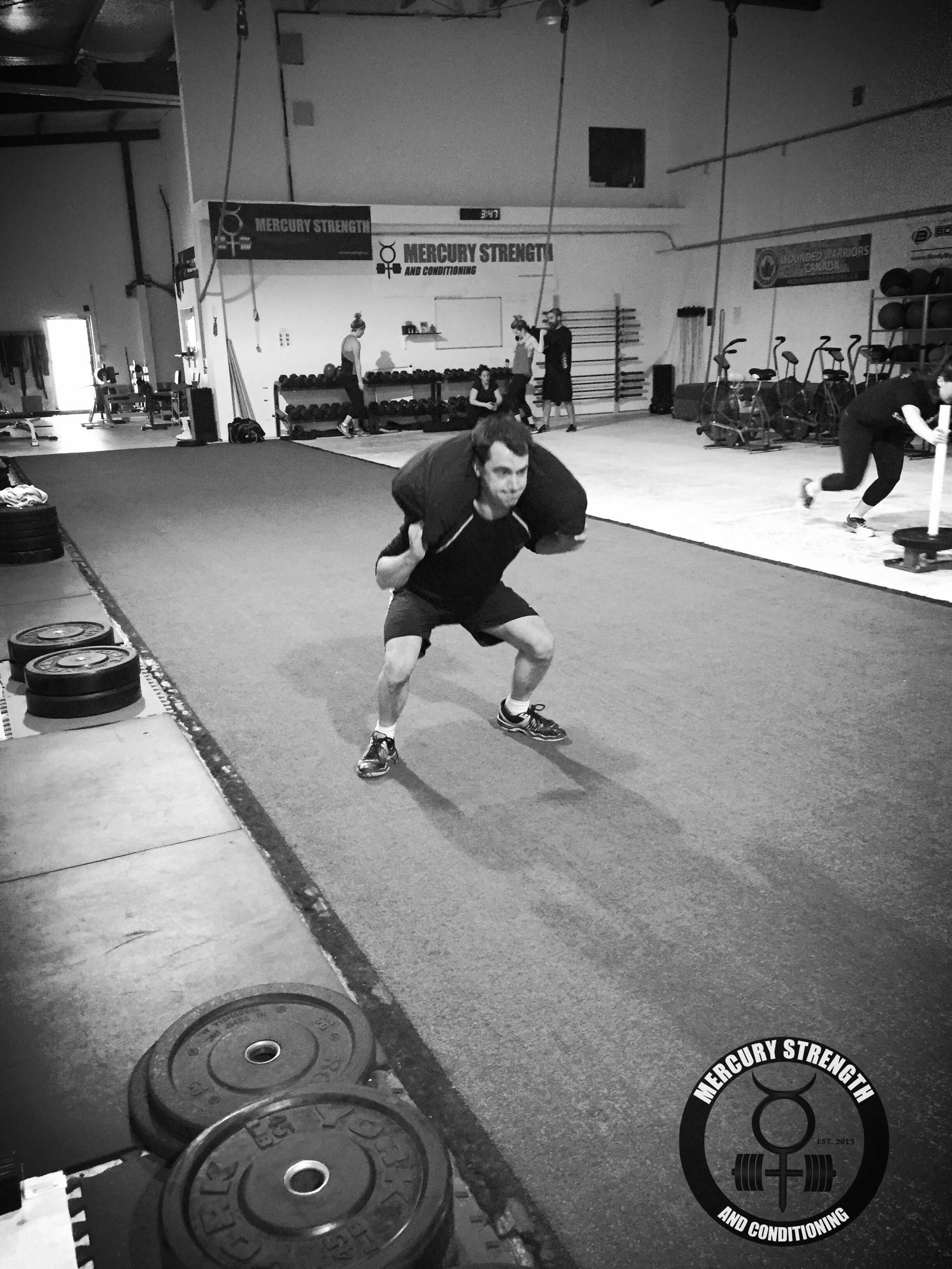 Nick with some weighted squat jumps during Saturday's session.