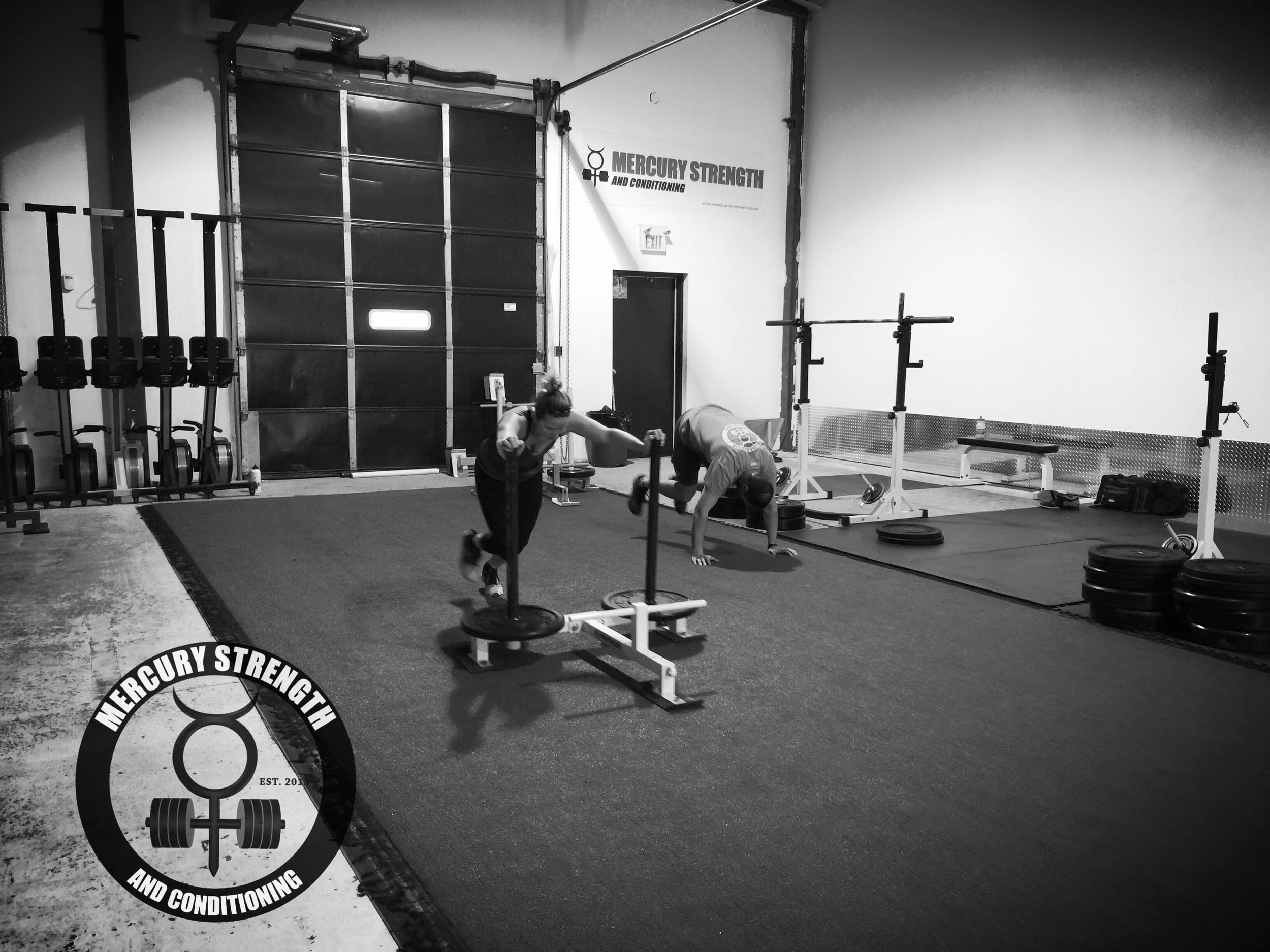 Kelly pushing the prowler while Jeff is getting some burpees done.