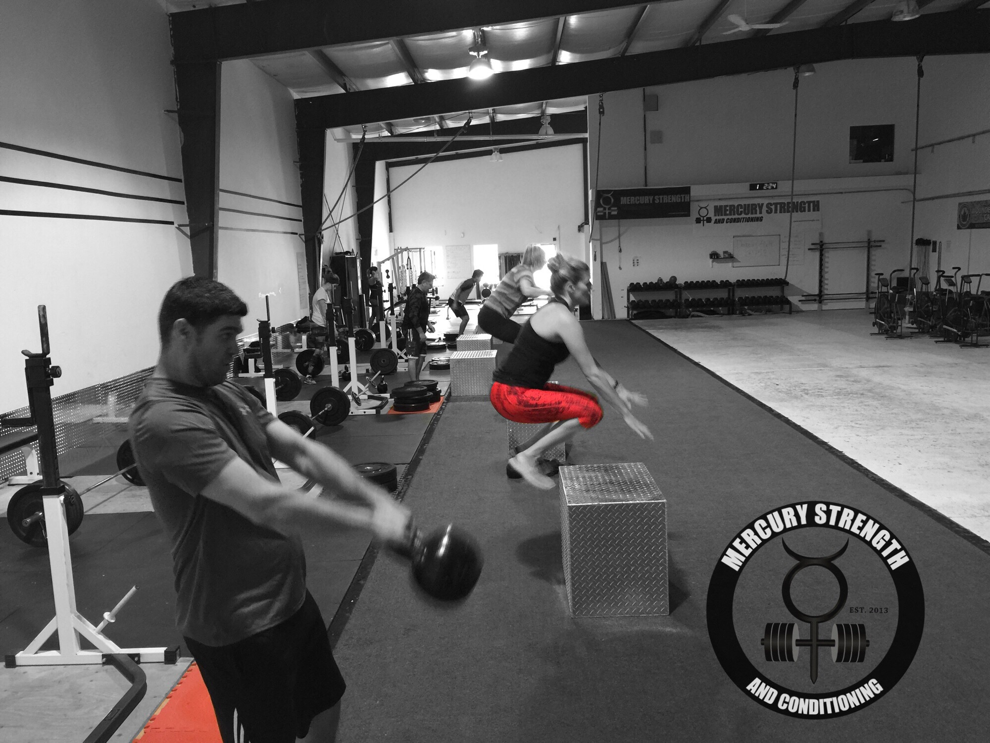 The 12:30 class crushing some deadlifts, box jumps, and kettlebell swings.