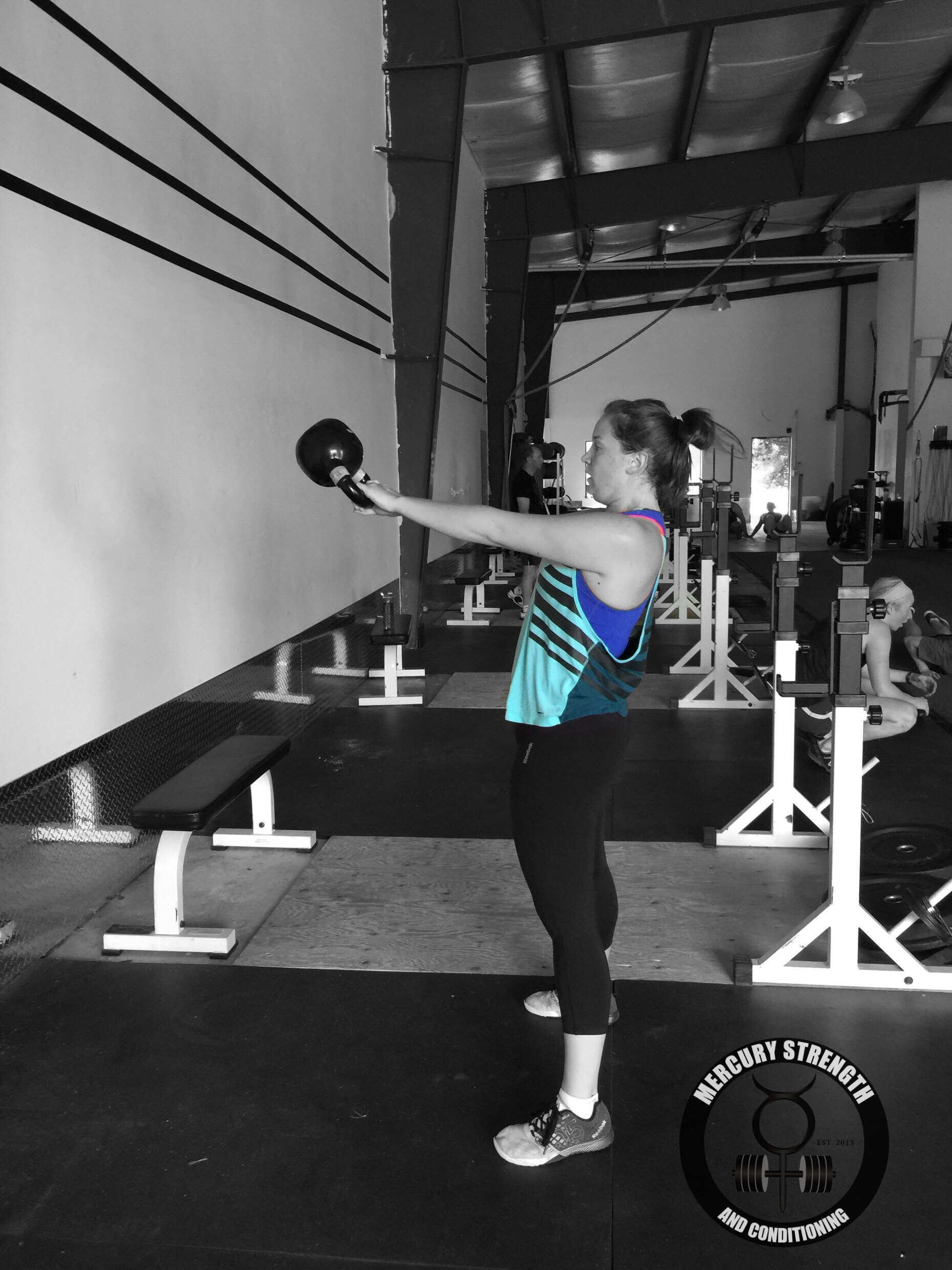 Meg with some kettle bell swings during Saturday's partner workout.