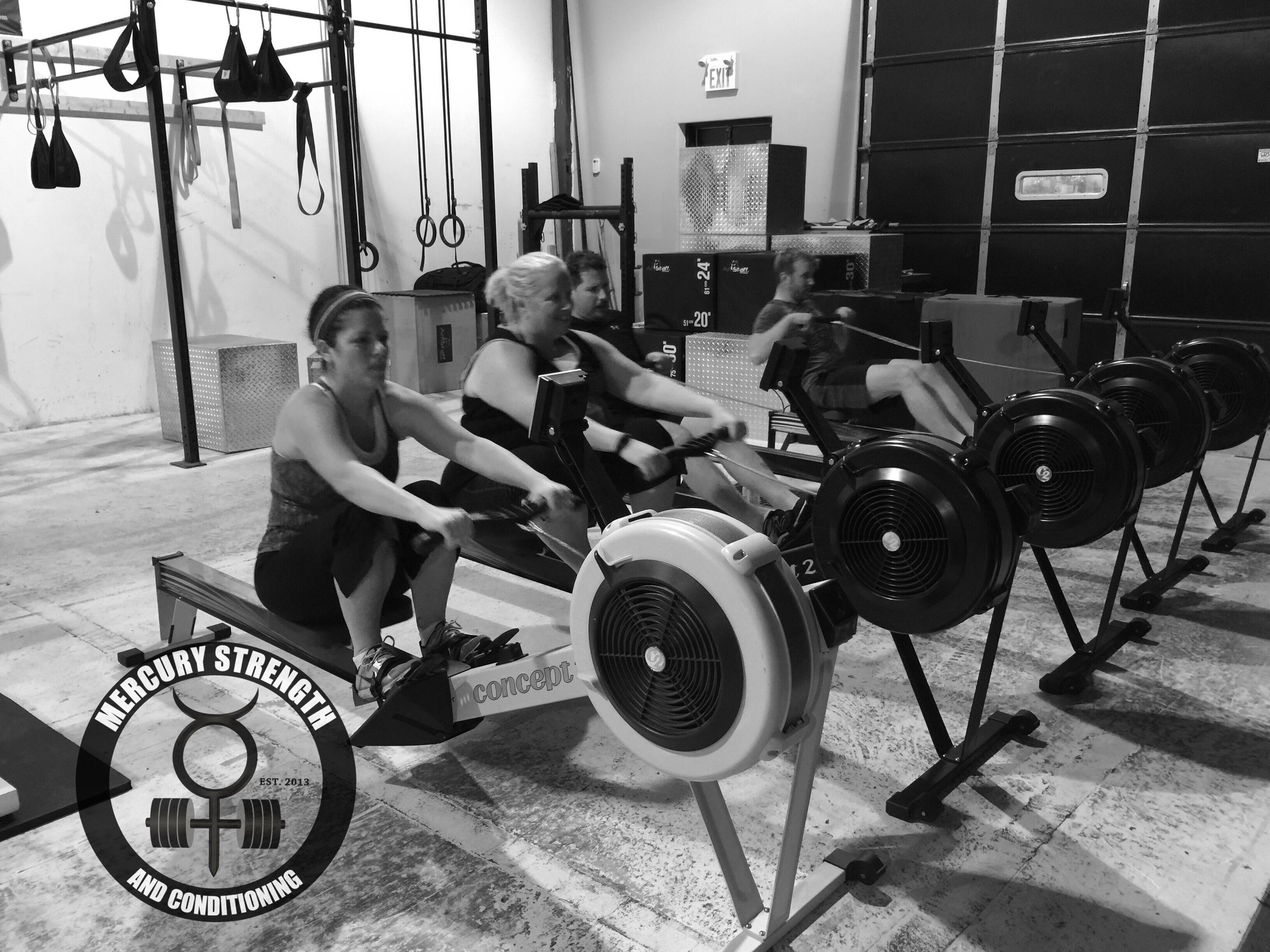 Jen, Angie, Steve, and Lucas getting an early start to the day with a max effort 500m row.
