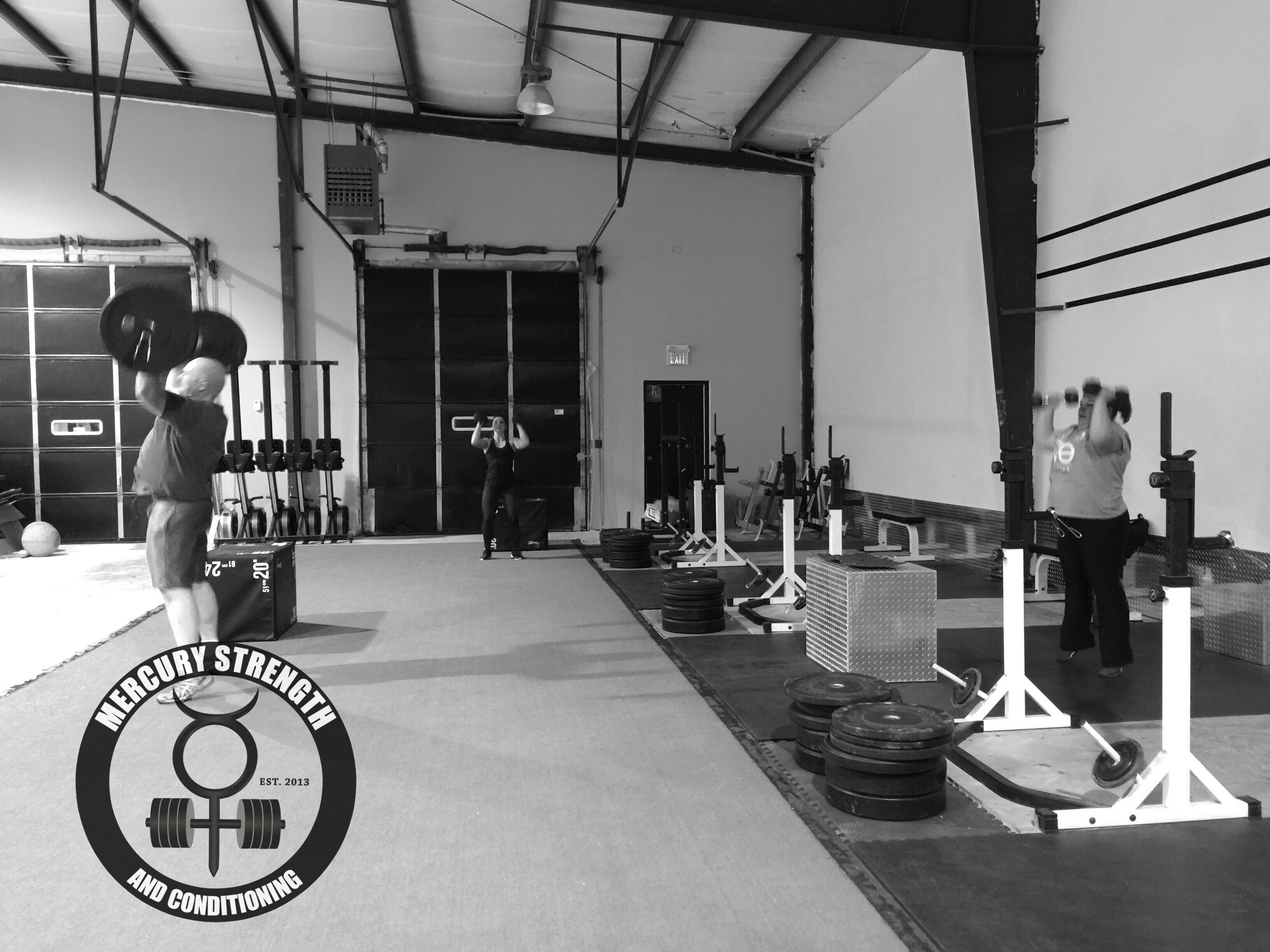 Jamie, Michele, and Lori getting some great hip drive on some push presses from last night.