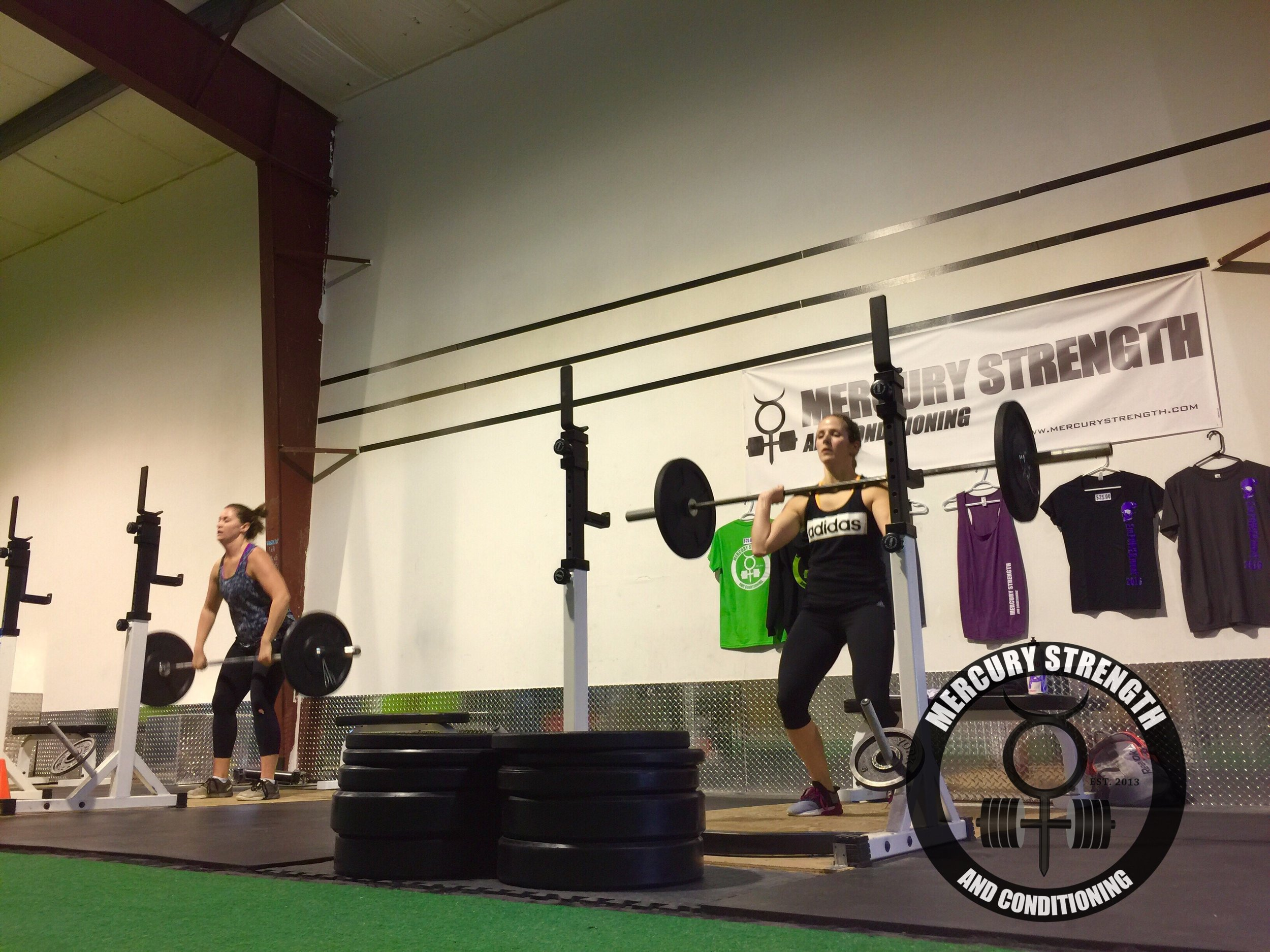 Meg and Kelsi with some power cleans during the power clean and burpee ladder. A great finisher to a tough day of training!