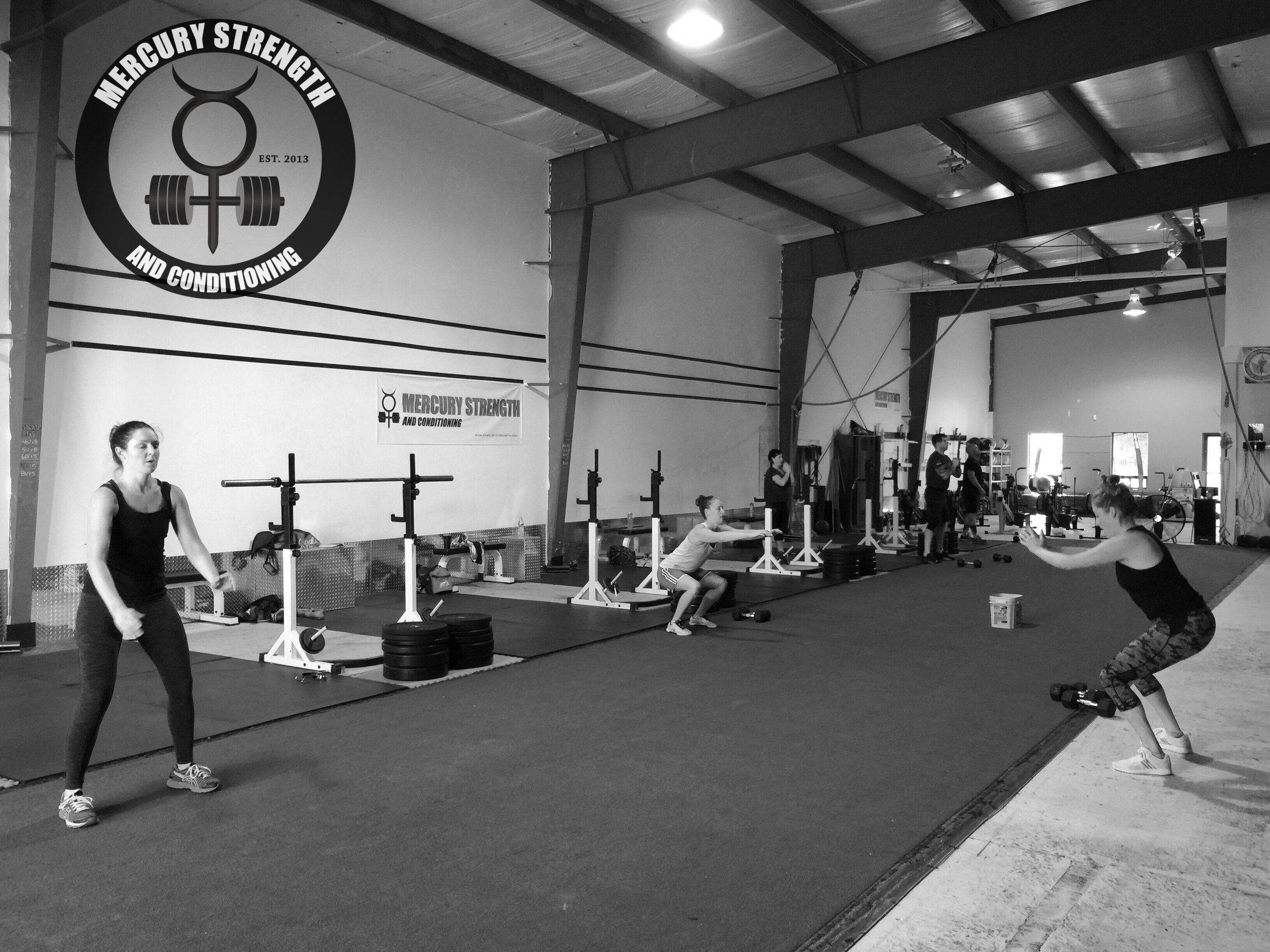 The 09:30 crew crushing out some squats before DB thrusters