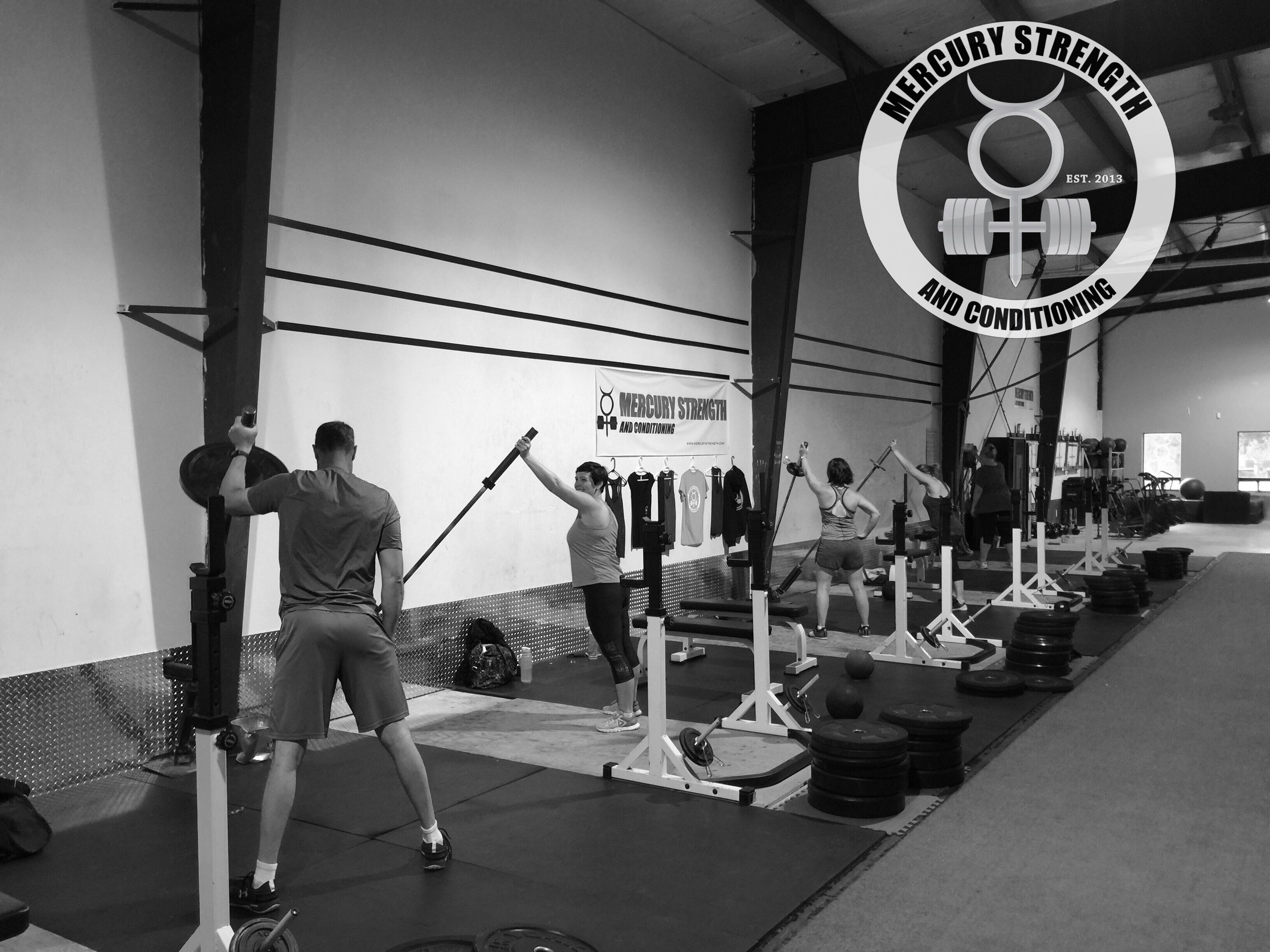 The early morning crew with some landmine presses