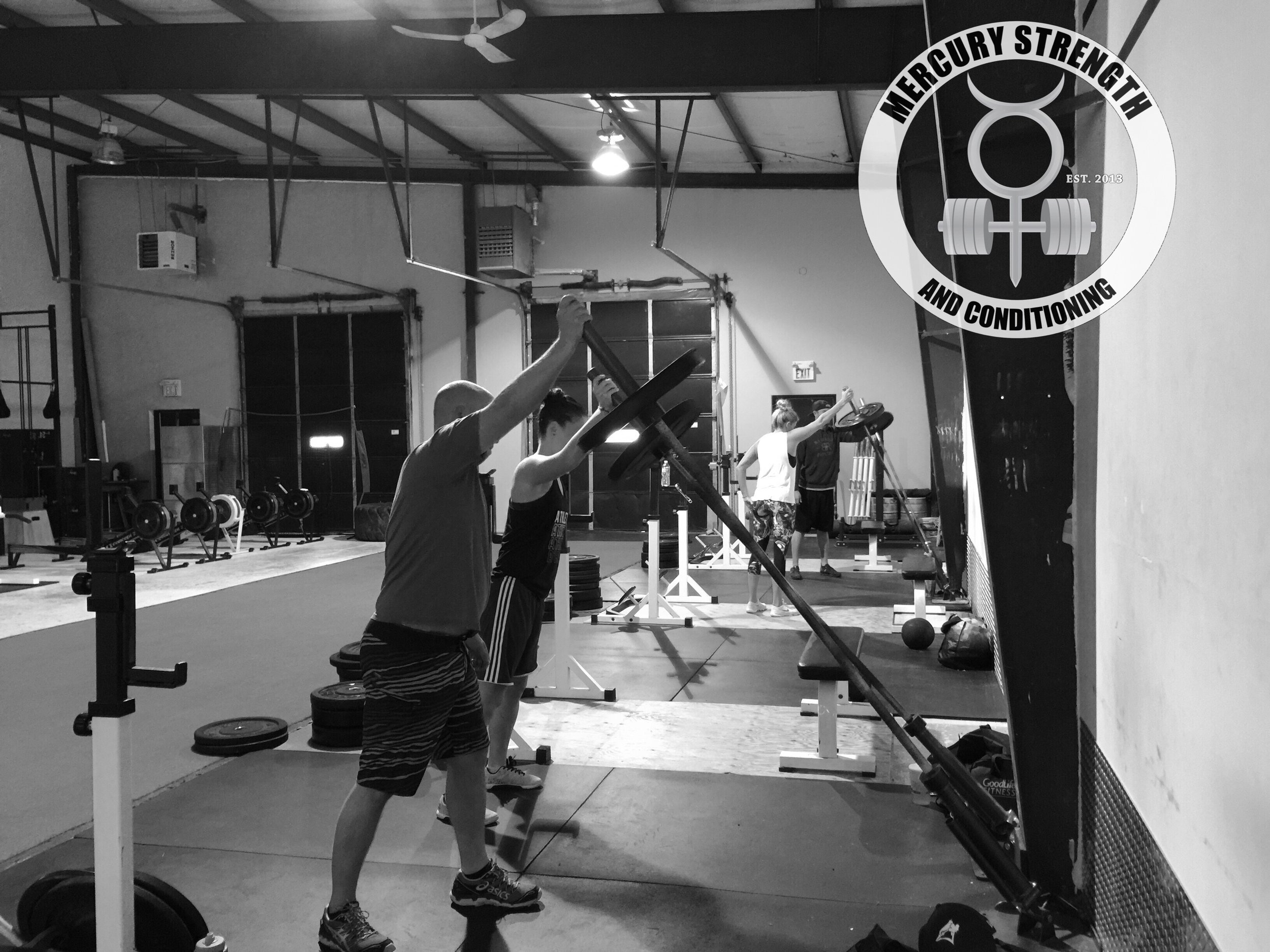 Colby, Katie, Janet, and Michael with some landmine presses