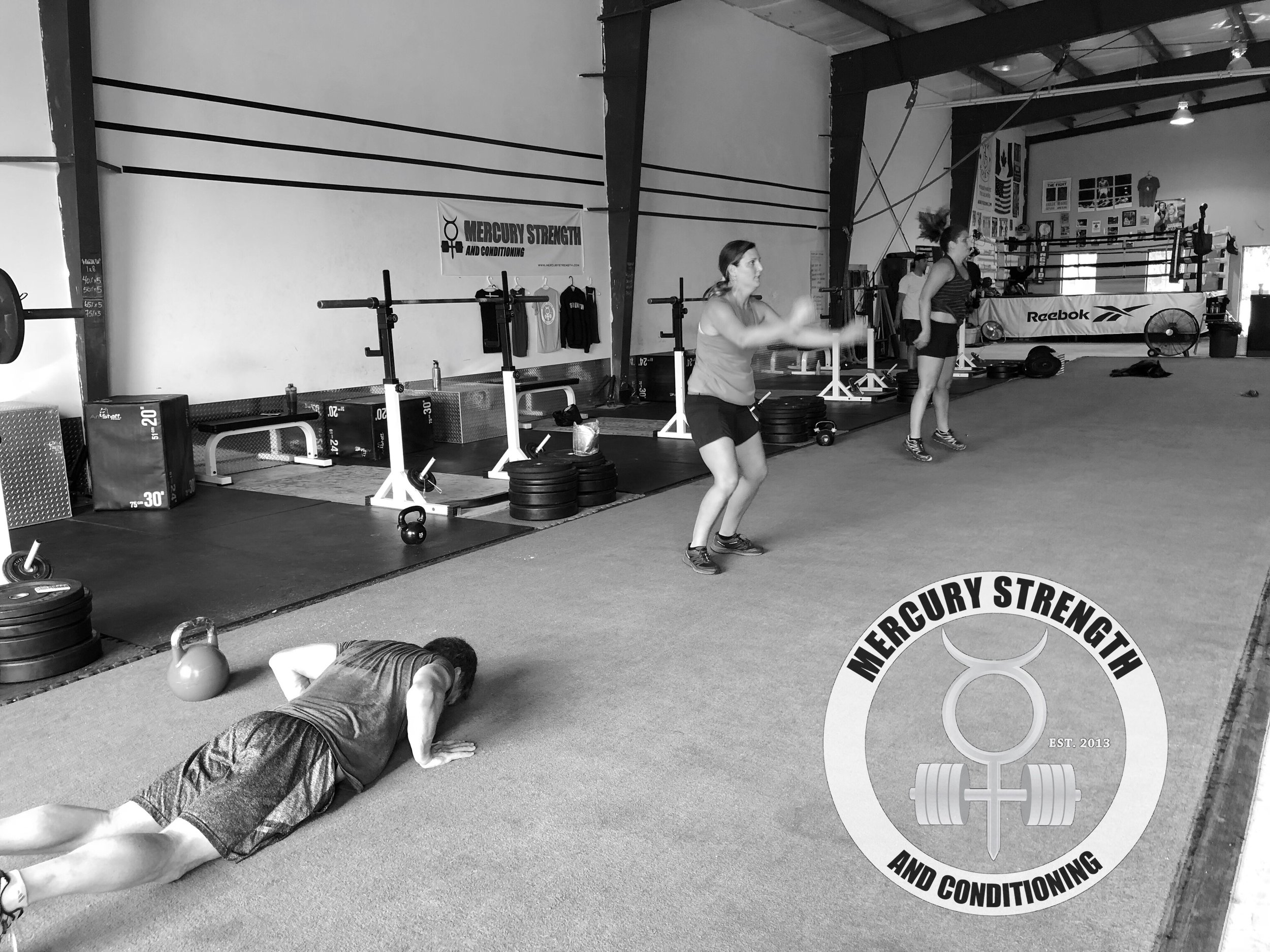 Paul, Kim, and Christine with some burpees during Tuesday's workout