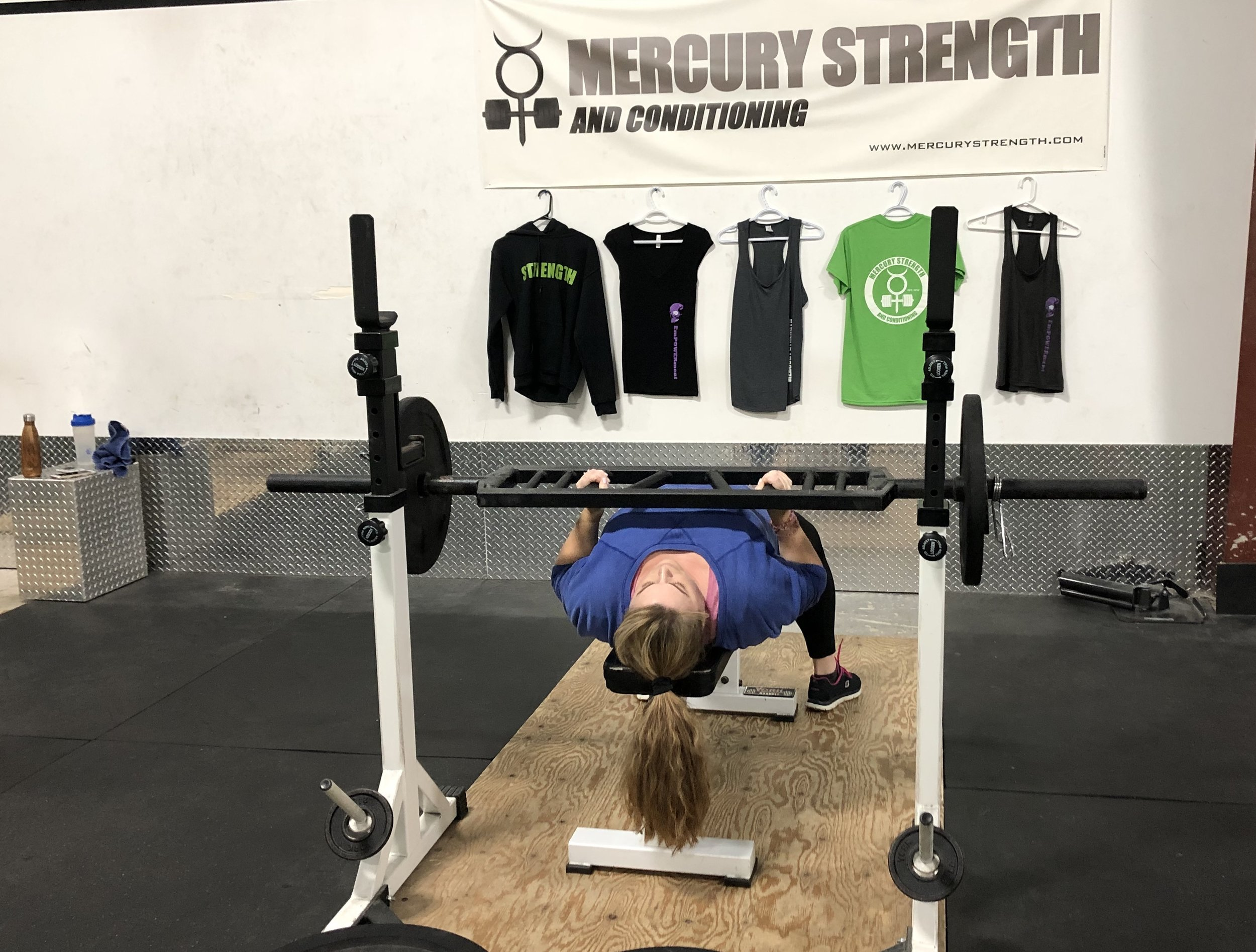 Tara using the Swiss bar for some bench press while recovering from a shoulder injury. We have the tools and expertise to get you moving like you did pre-injury.