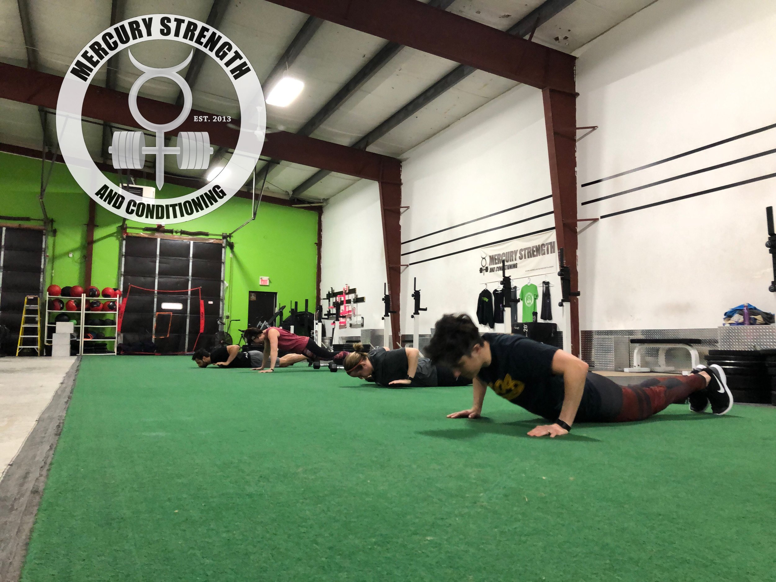 Michelle, Tara, Shawna and Mike with some hand release push-ups to ensure full range of motion.