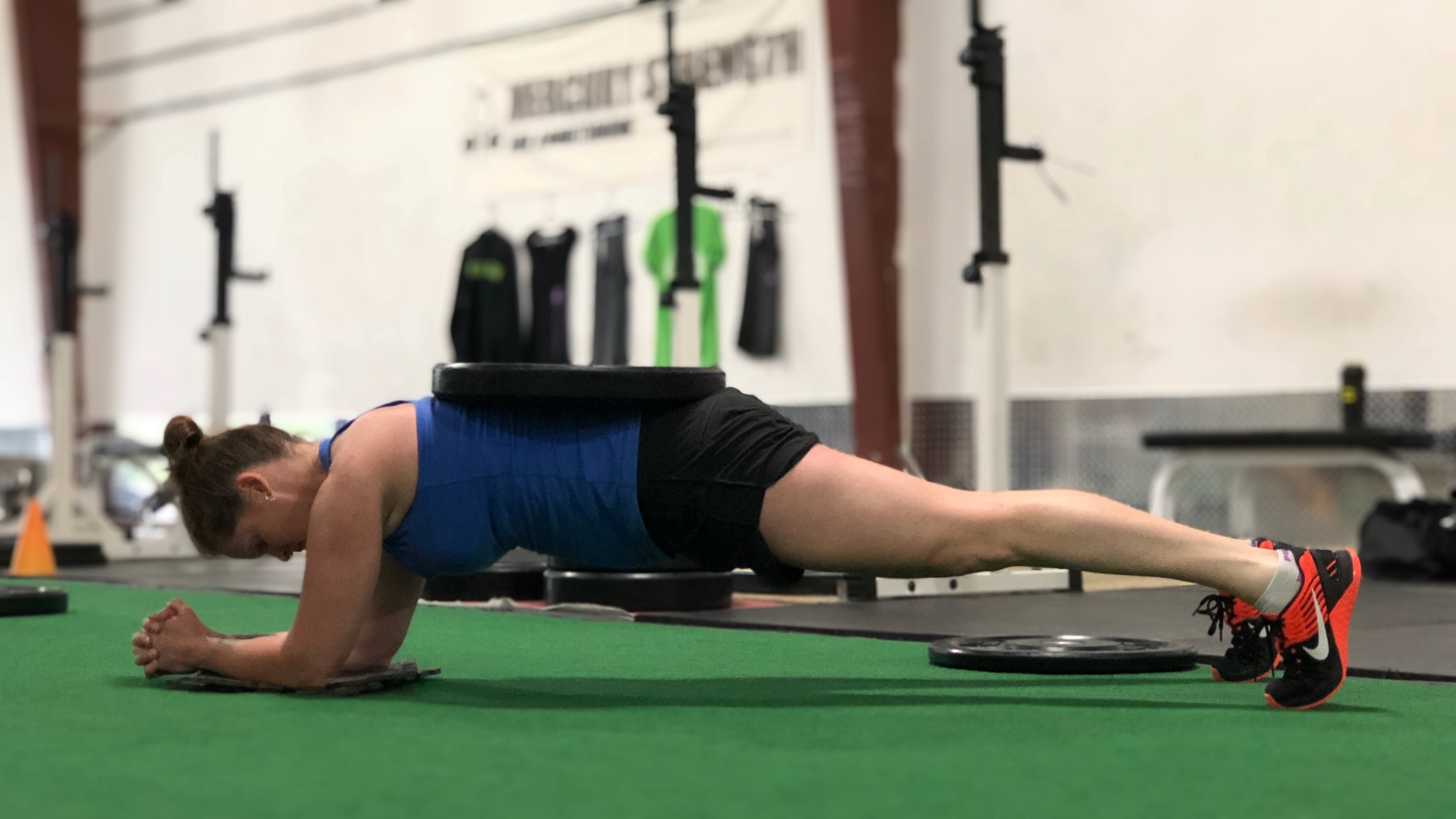 Cari holding a weighted plank