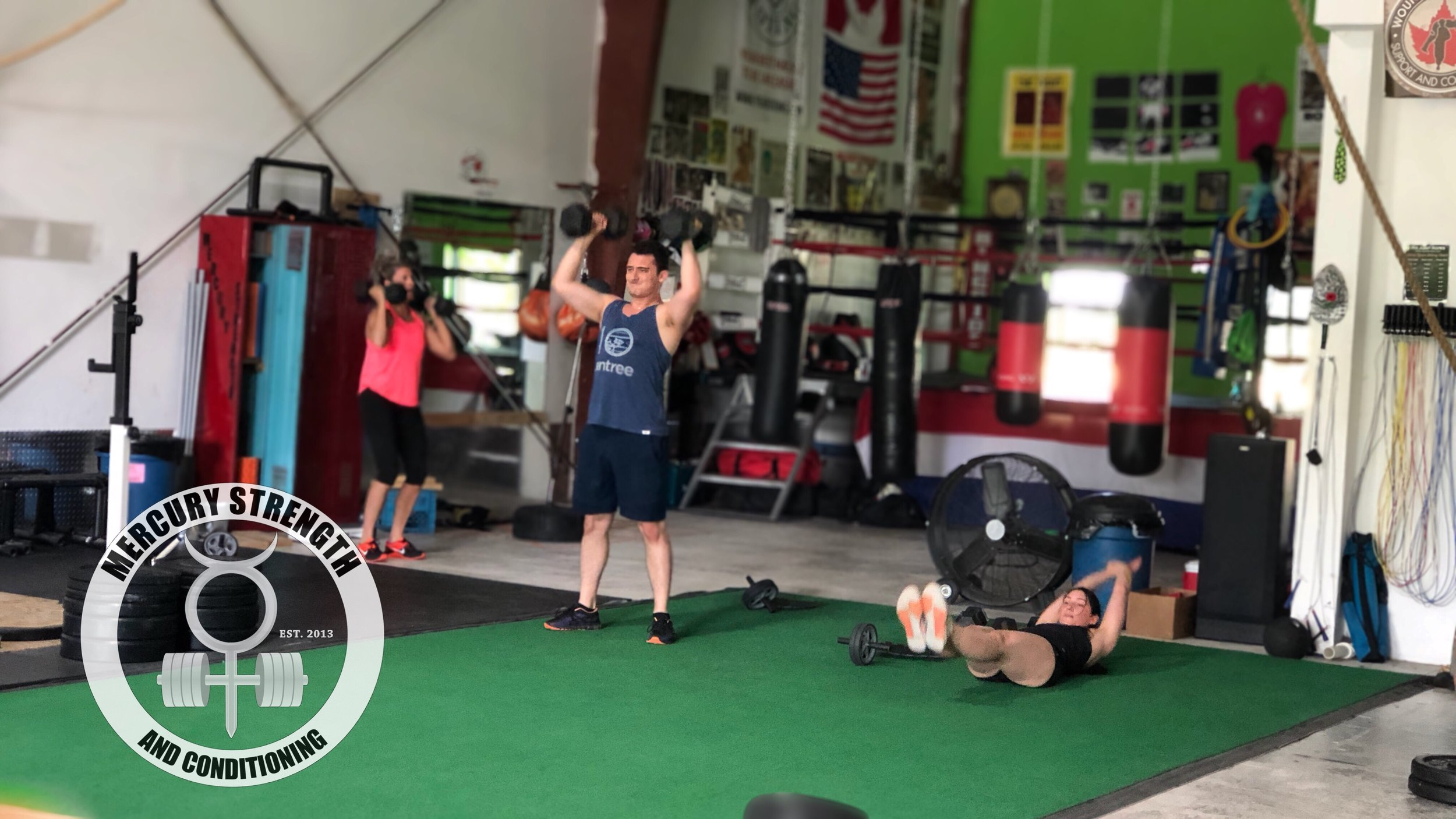 Janet, Eddy, and Mel hitting some DB push presses and hollow rocks