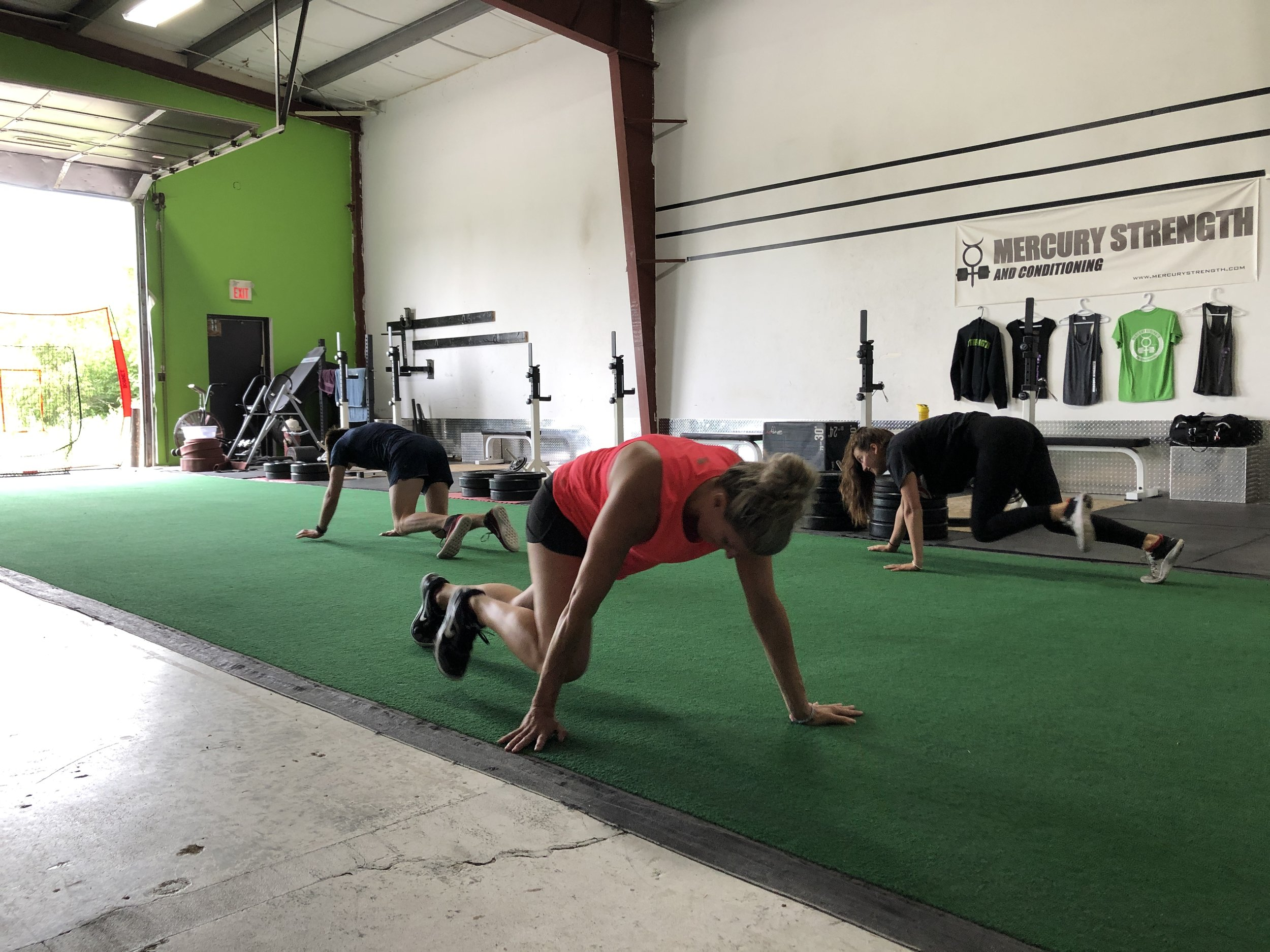 Janet, Sydney and Joshua firing up those quads with some bear crawls