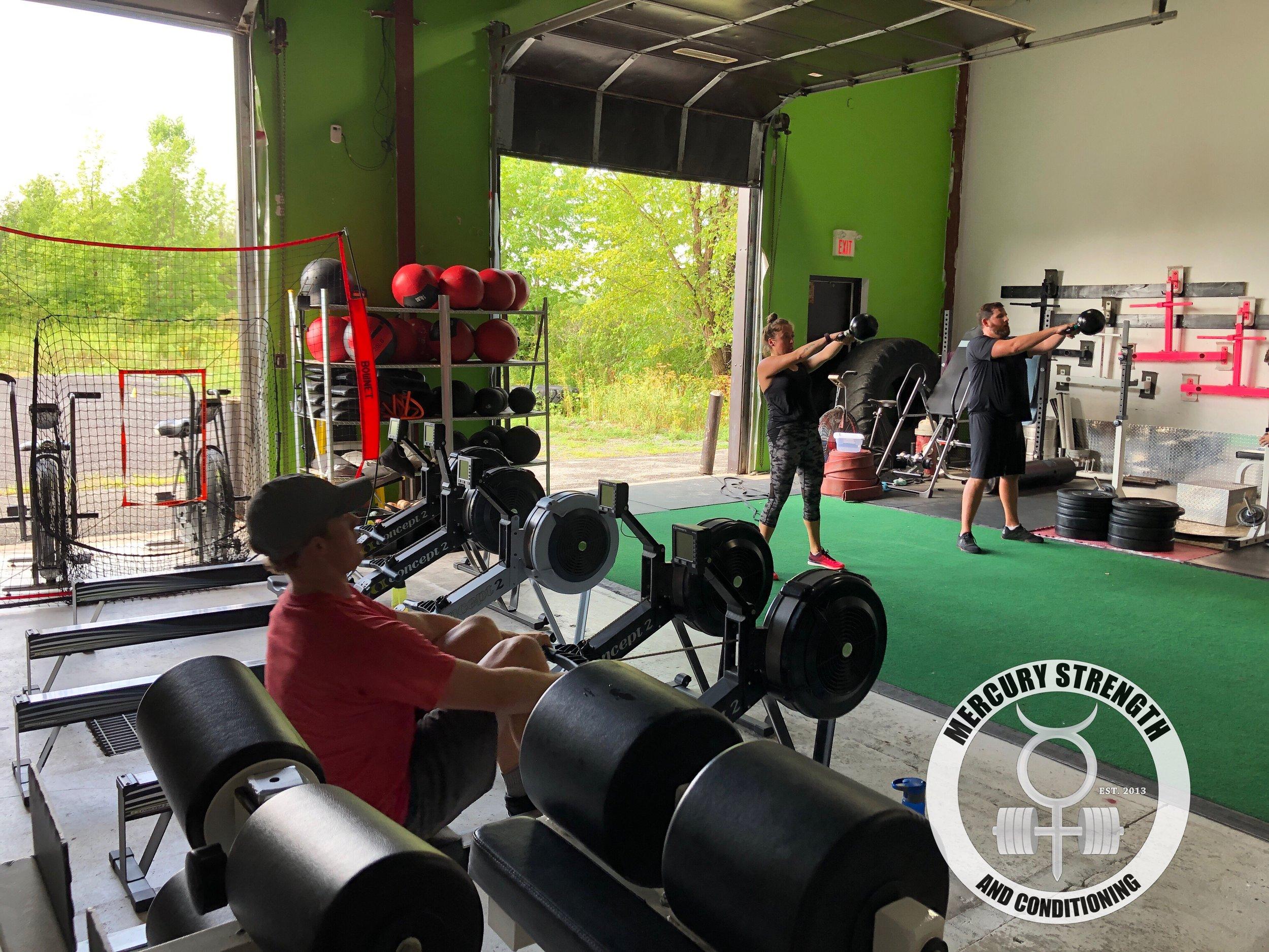 Gym-powerlifting-fitness-personal training-training-bootcamp-crossfit-kingston-kingston gym-kids-mercury-strength-conditioning-athlete-Row-KB Swing