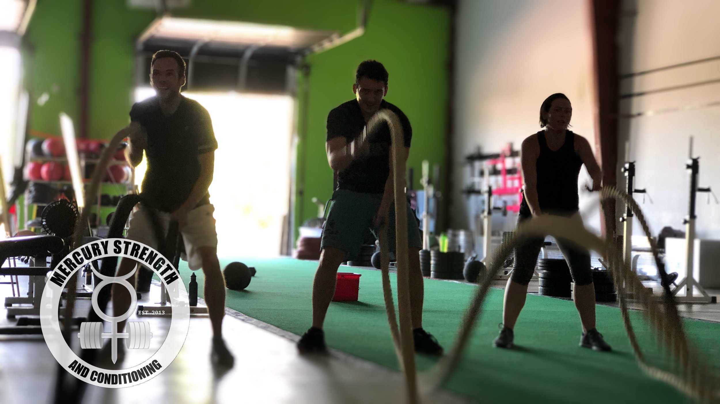 Ryan, Eddy, and Lindsey with some battle ropes on a Saturday