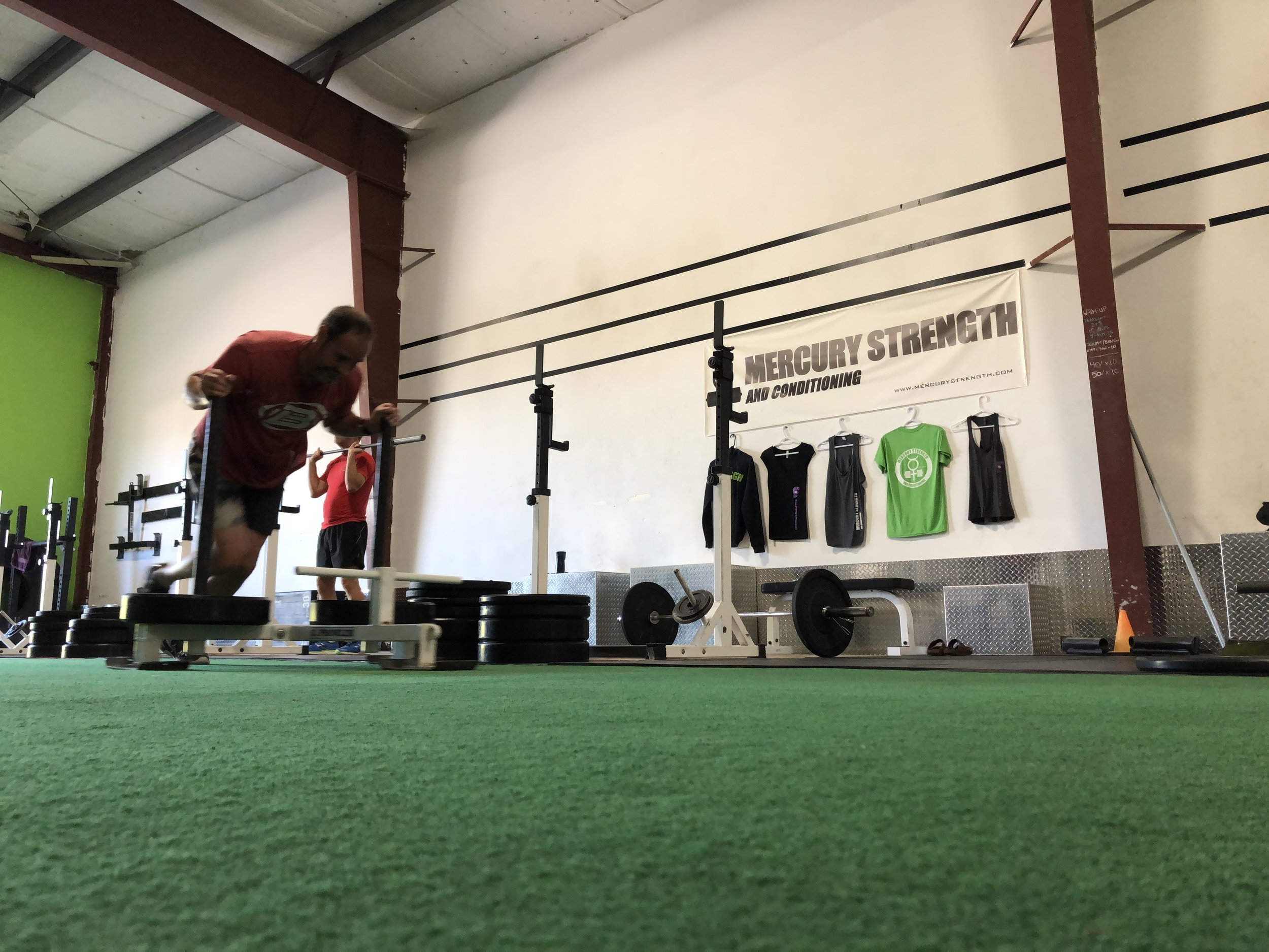 Andrew sprinting with the prowler