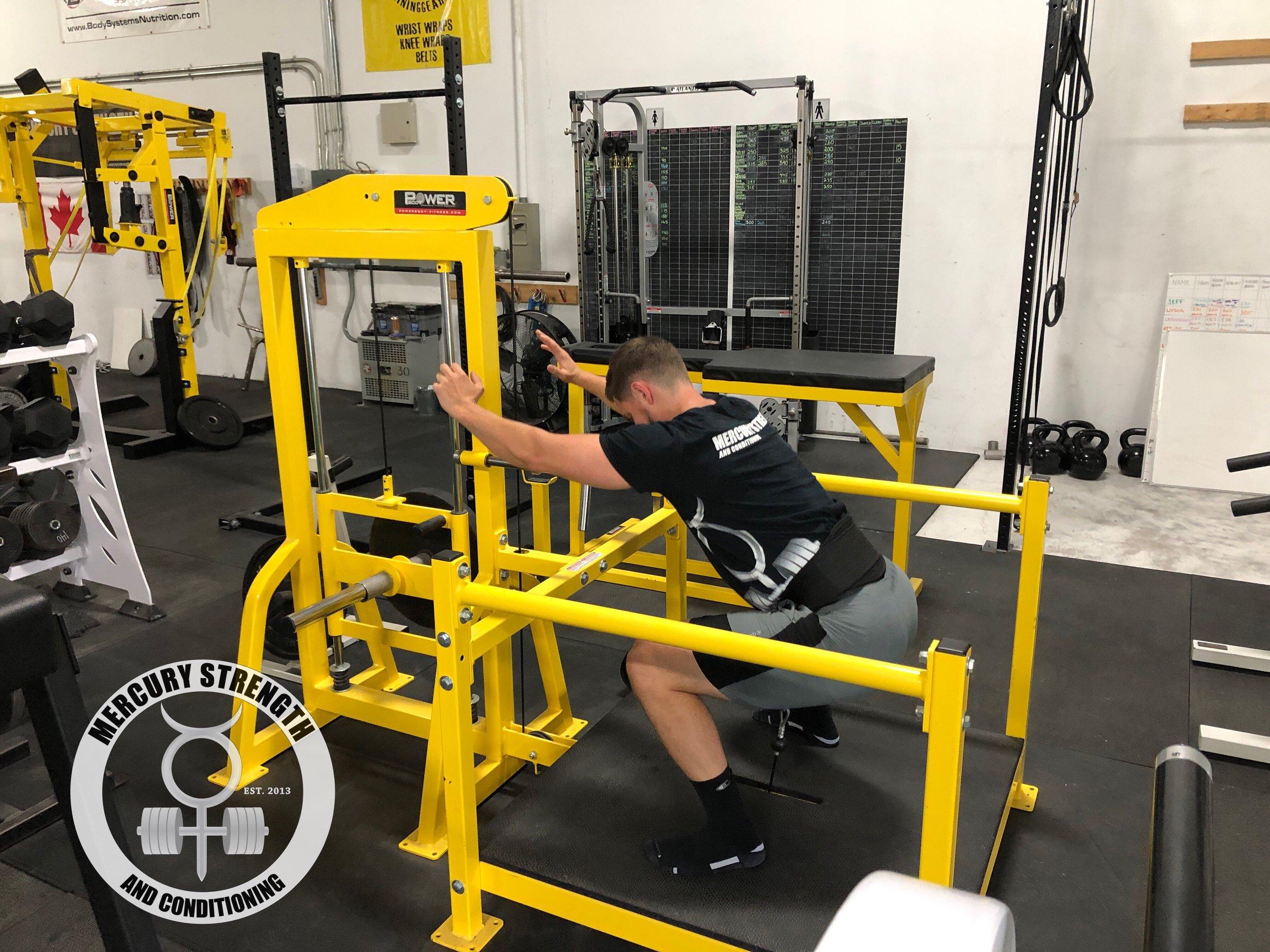 Dr. Elliott Perkins working on some accessory stuff using the belt squat machine.