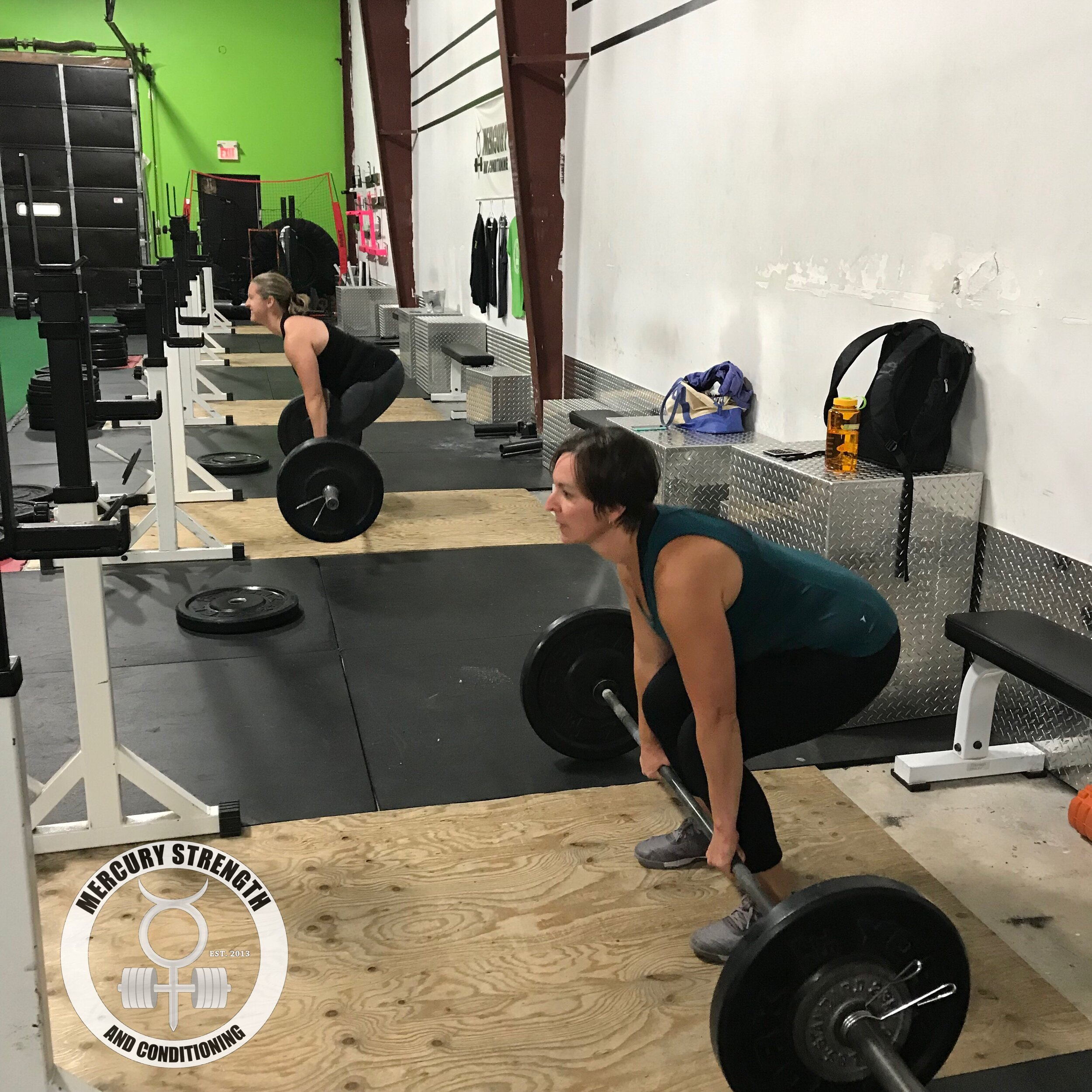 Jessica and Tara keeping the wedge while deadlifting.