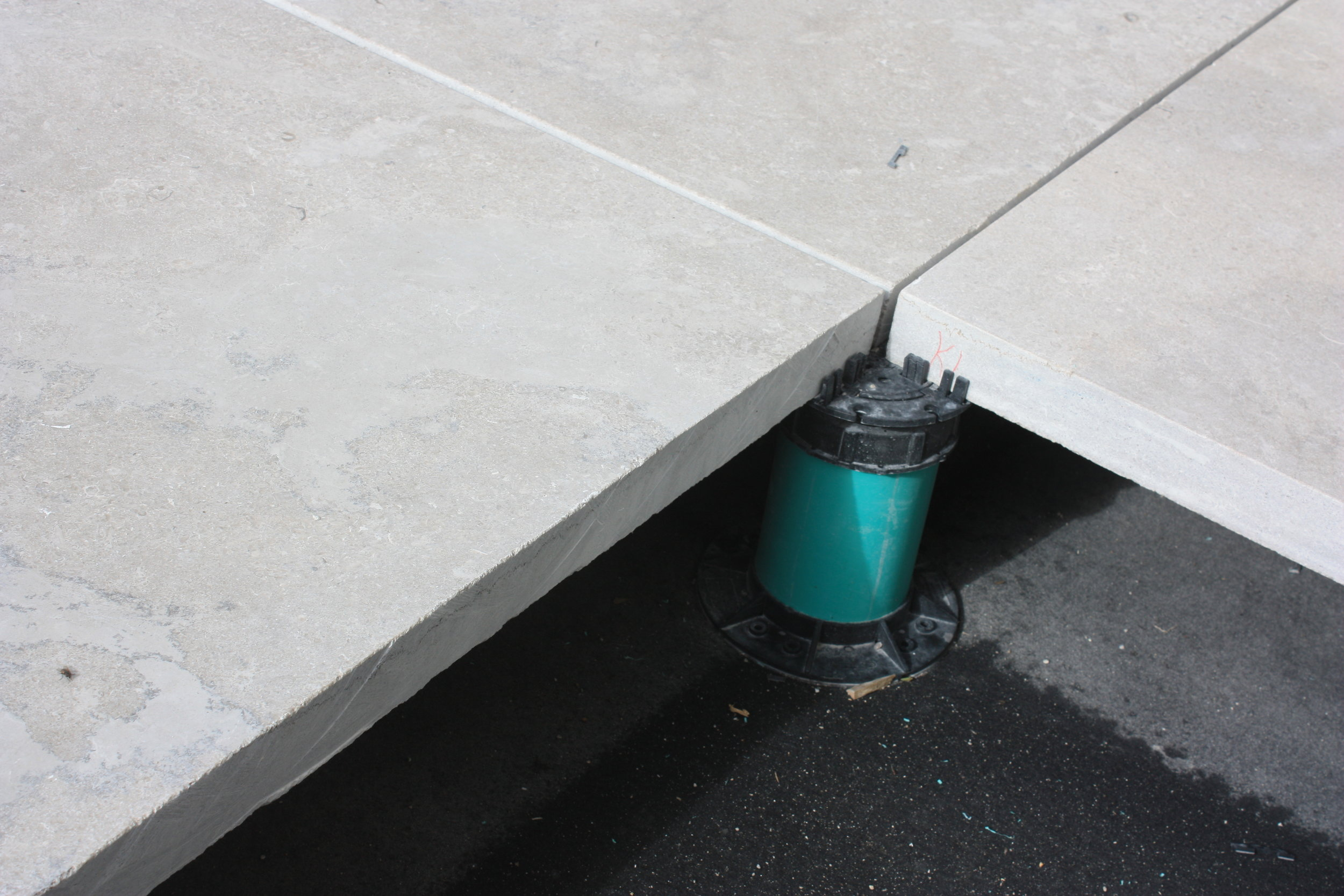 For this project, a pedestal system is being used to install the pavers instead of a base material.