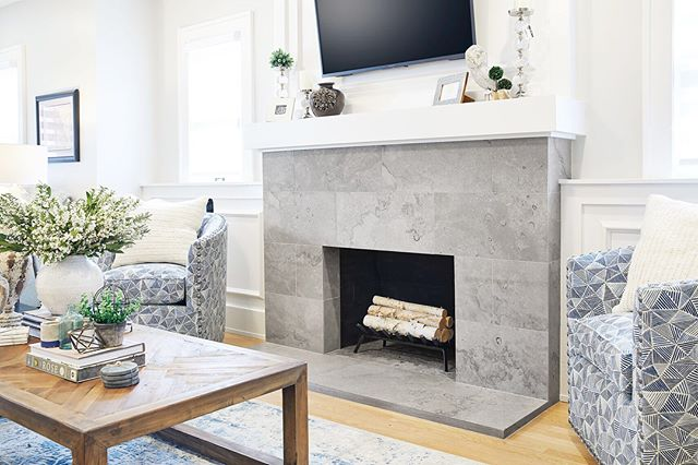 #fireplacefriday This beautiful hearth is in the @ellecordesign showroom and features our Fleuri tile for a more modern look.