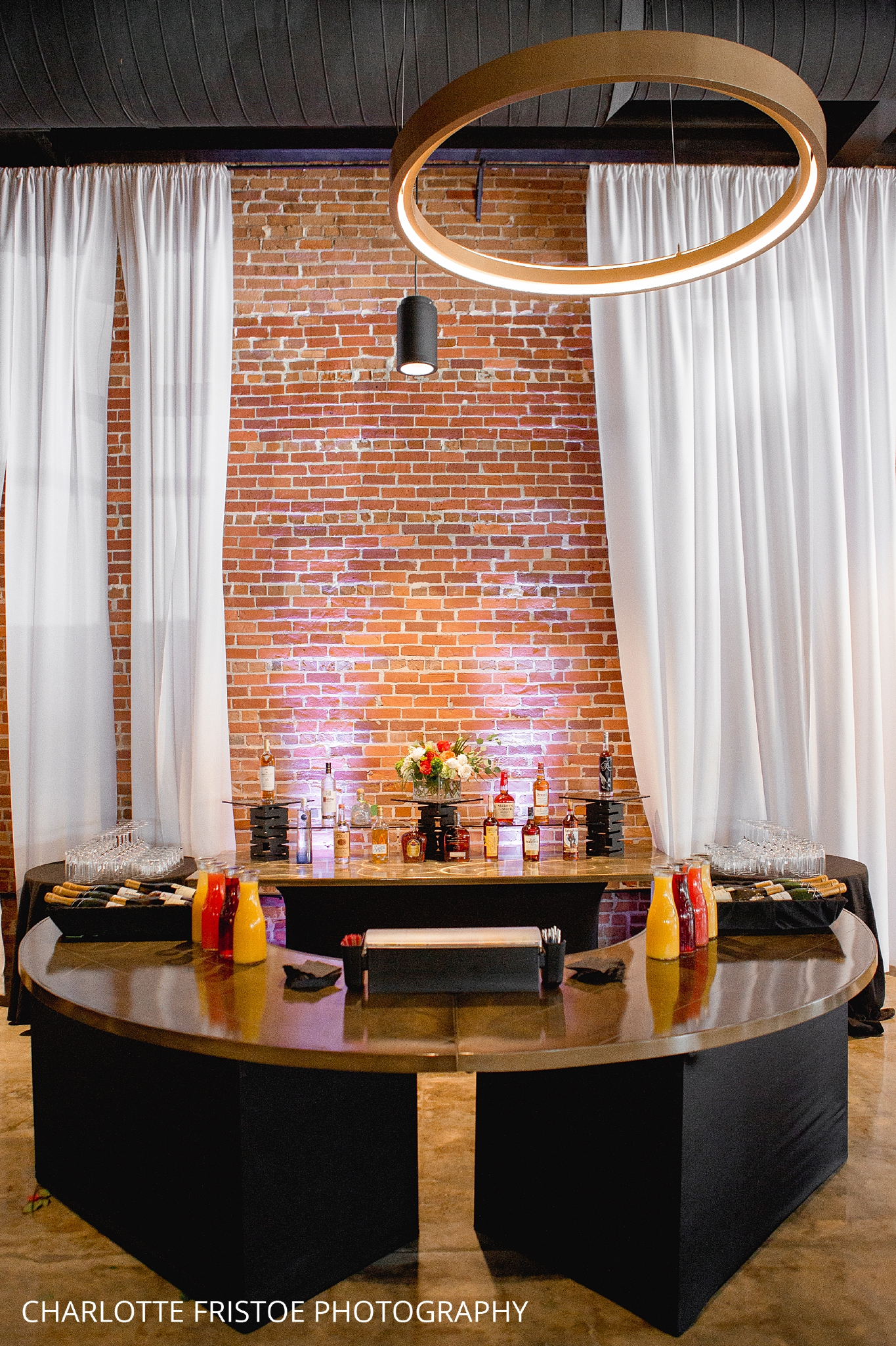 Bricks and brass bar wedding.jpg