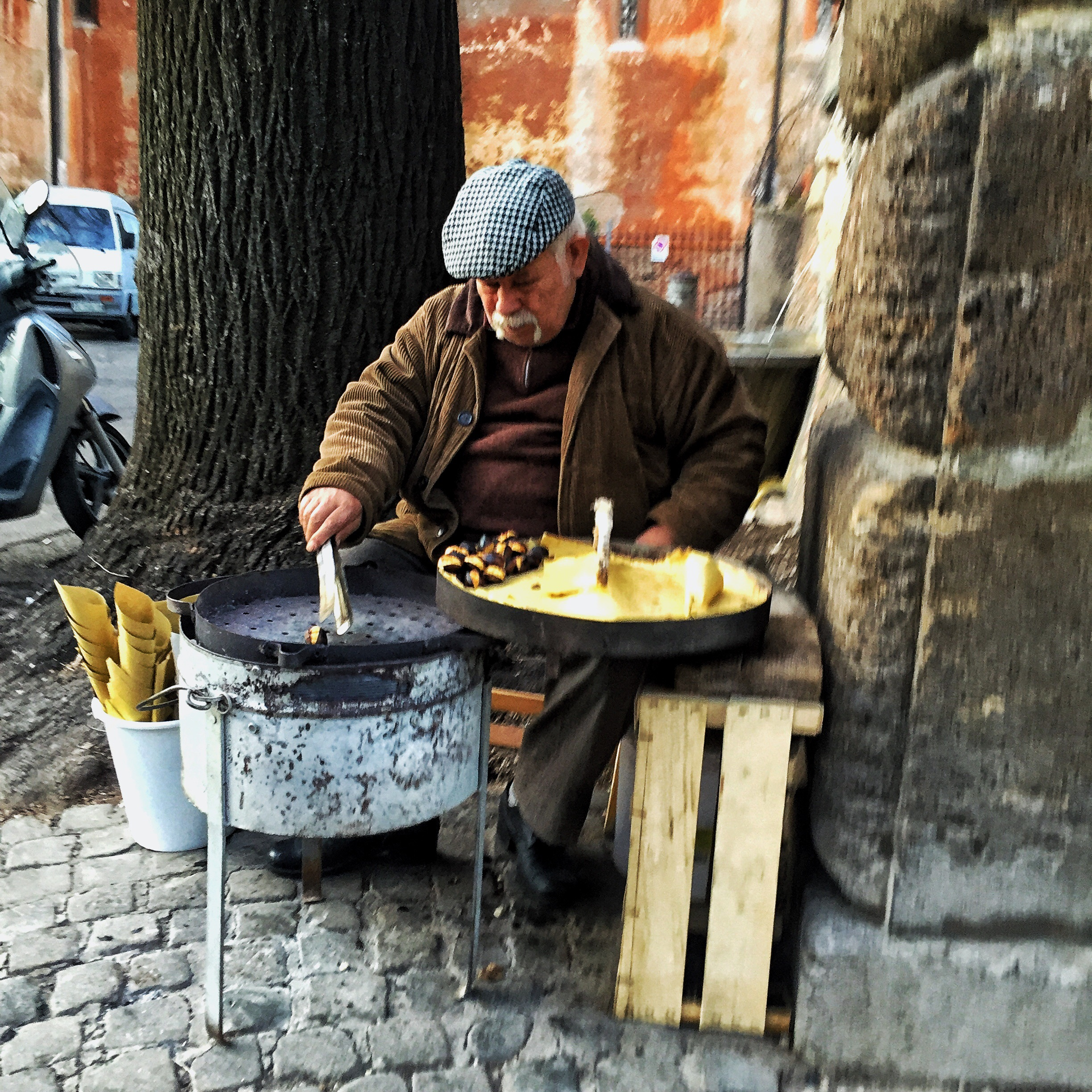 Old Italian man selling chestnuts