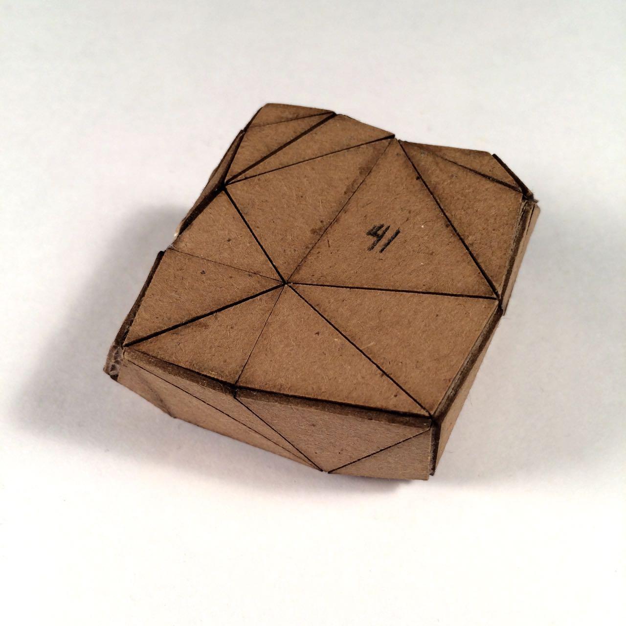 (Front view) 024 - Boxes For Rocks, 2012, laser cut cardboard, found rocks, glue, 9cm x 7cm x 3cm (flat bottom), 250 CAD