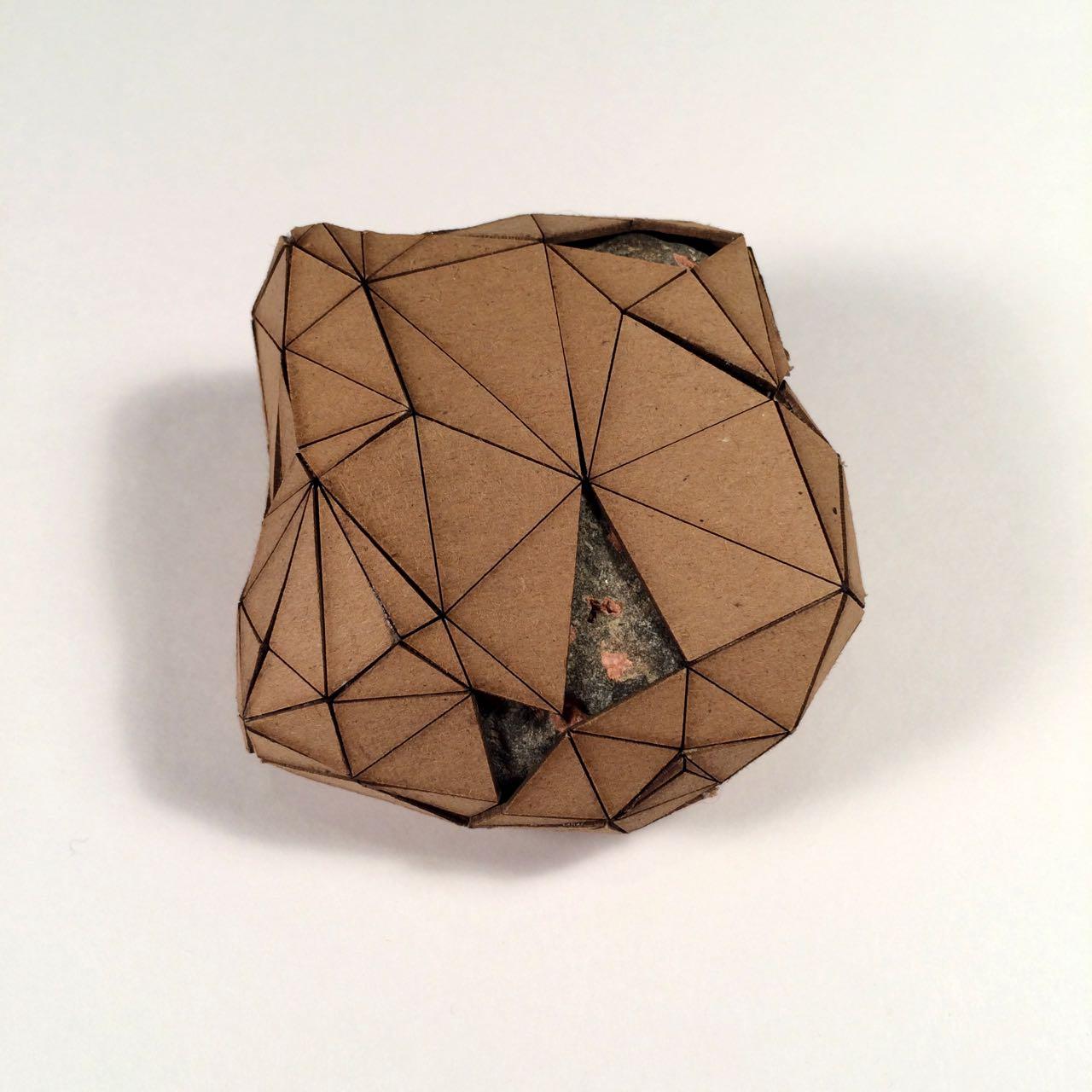 (Back view) 038 - Boxes For Rocks, 2012, laser cut cardboard, found rocks, glue, 9.5cm x 9cm x 4.5cm (roundish), 250 CAD