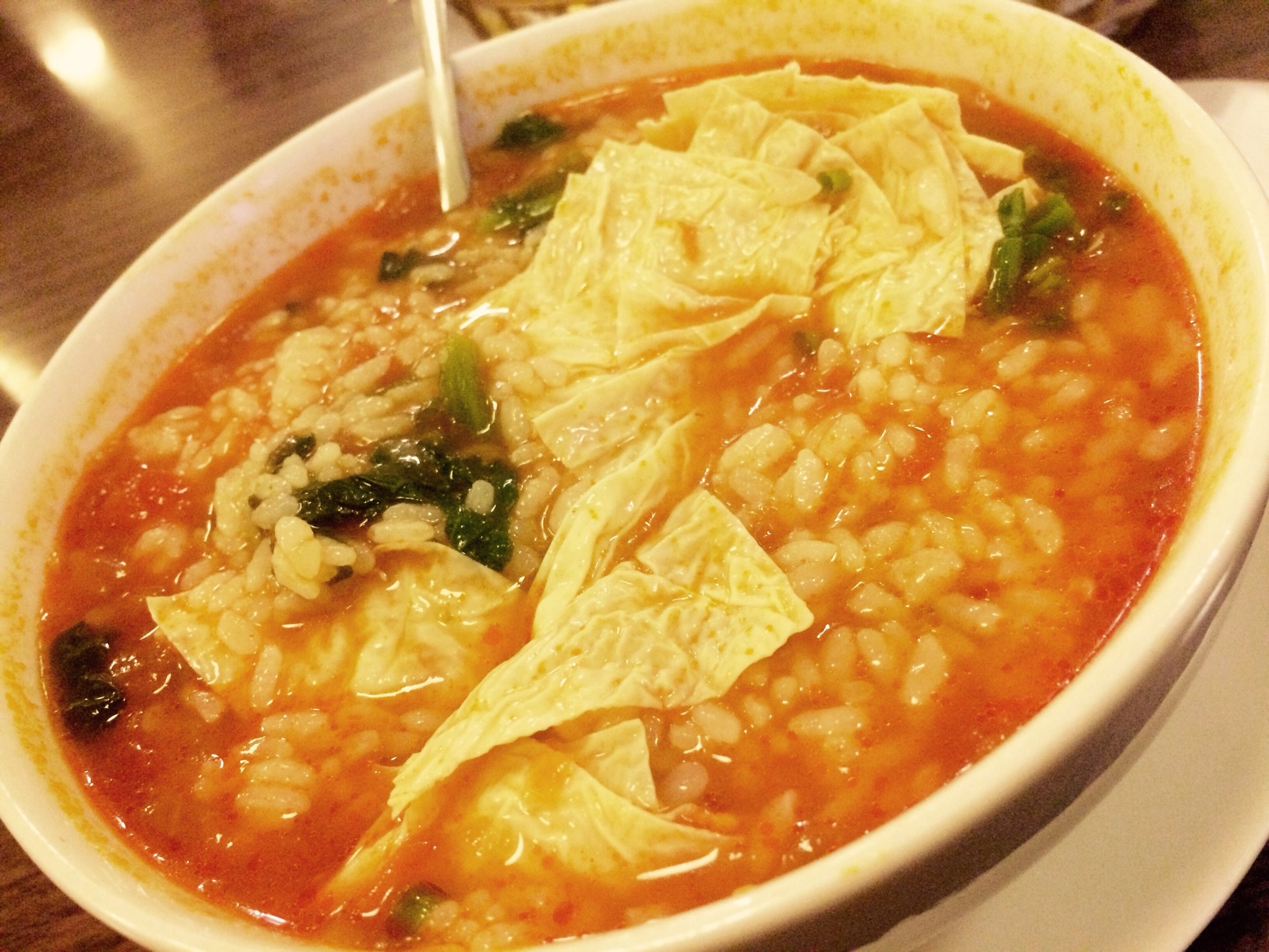 Tomato-miso soup with rice, spinach, and rice paper.