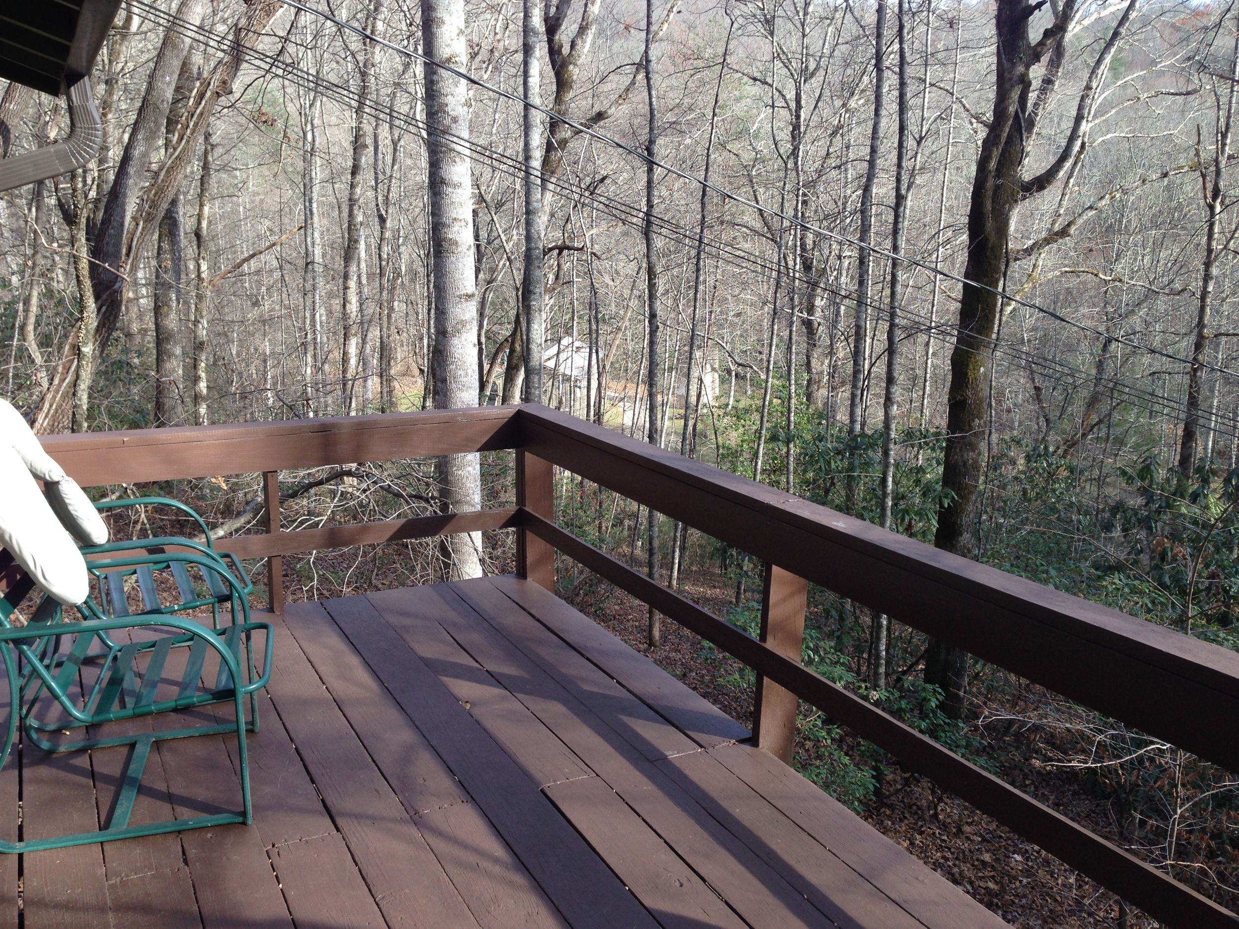 Porch overlooking the forest and some of the property