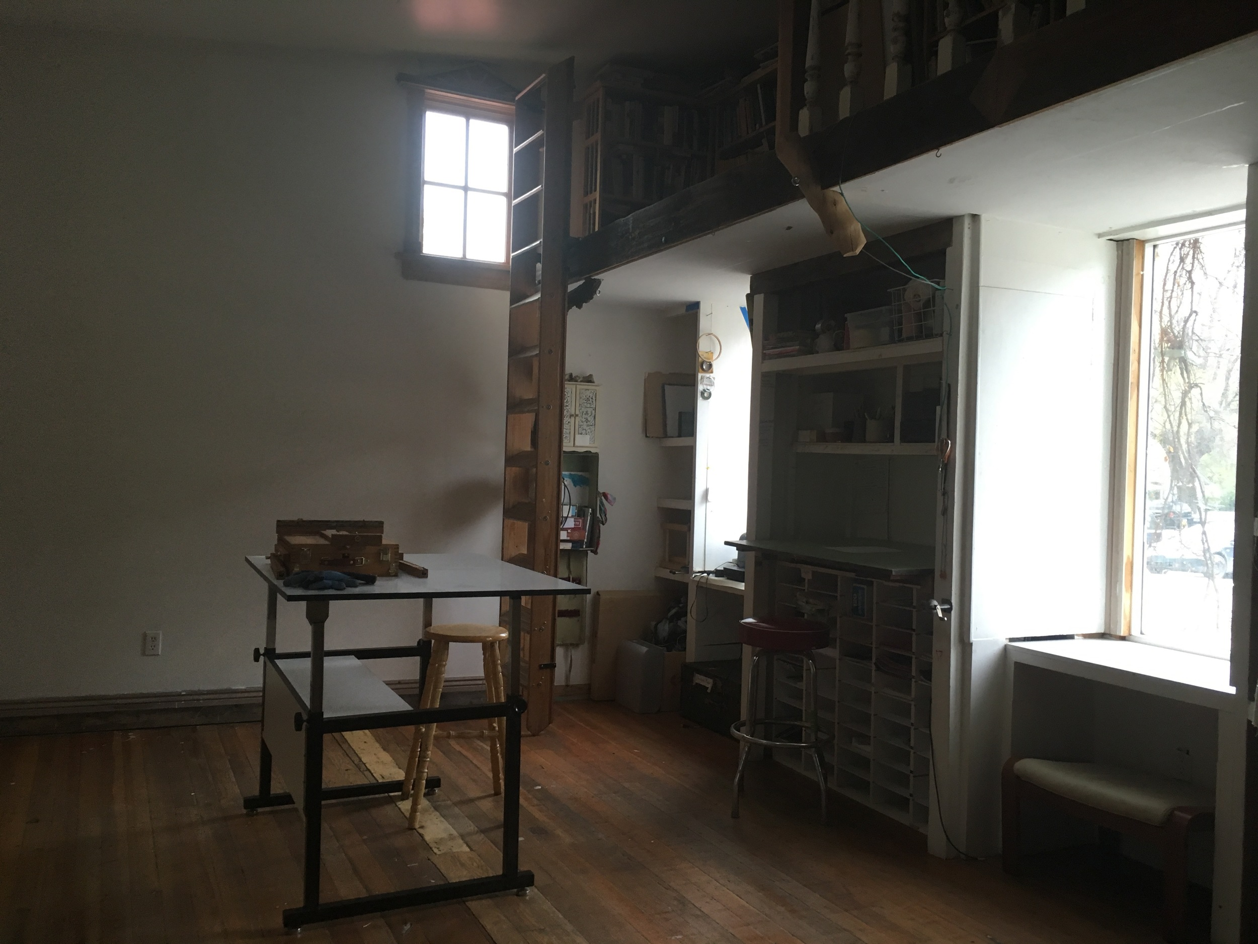 The art studio, for visual artists. There are a bunch of windows and wall canvas spaces, plus a sliding ladder library!