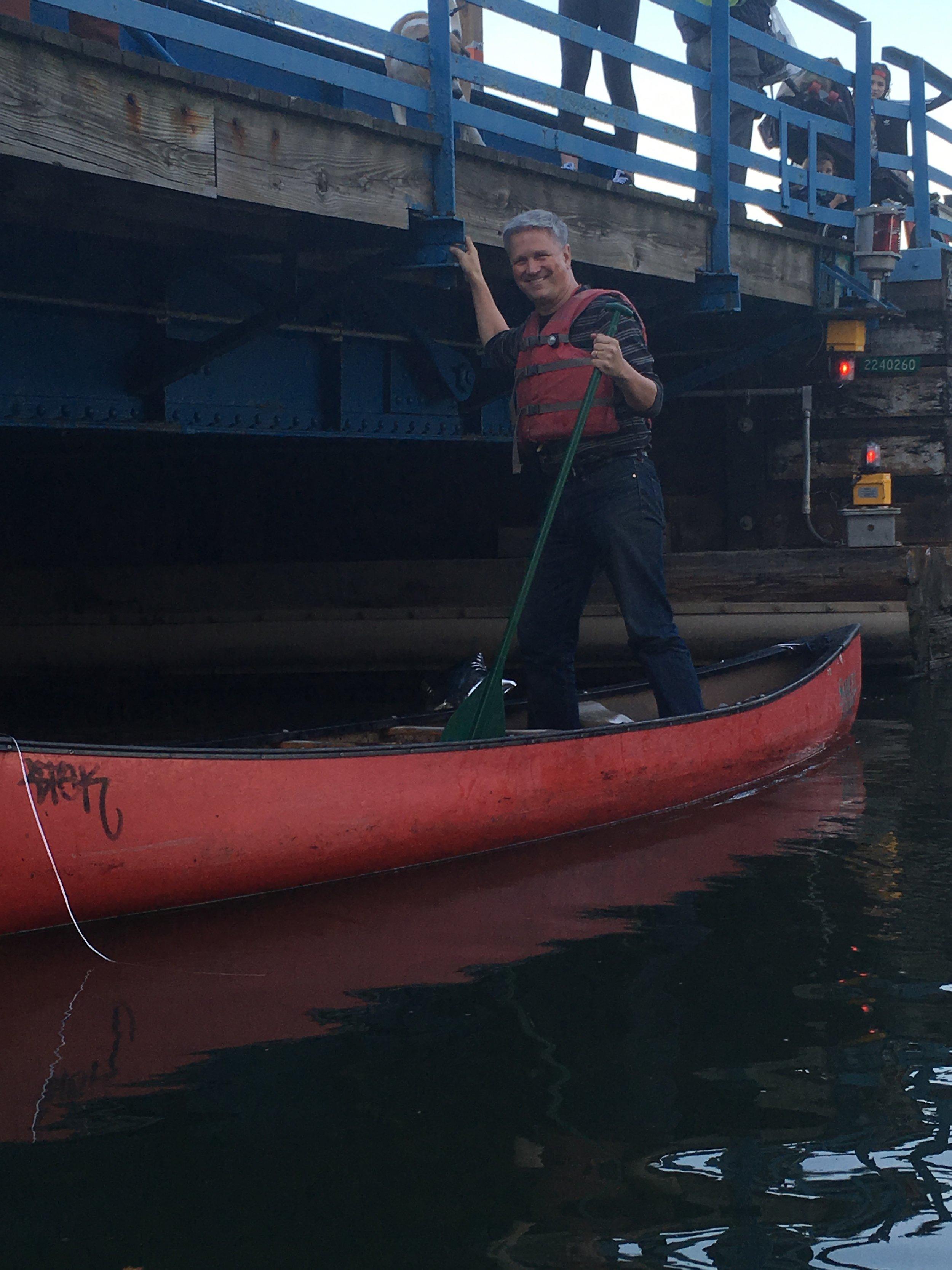 Owen captaining his canoe.