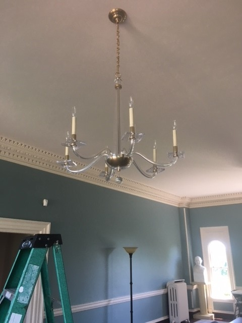 IT TOOK MANY MONTHS BEFORE WE WERE ABLE TO INSTALL NEW, MODERN CHANDELIERS INTO THE SPACE (WE SPENT A LONG TIME TRYING TO RESTORE THE HISTORIC ONES, TO NO AVAIL)
