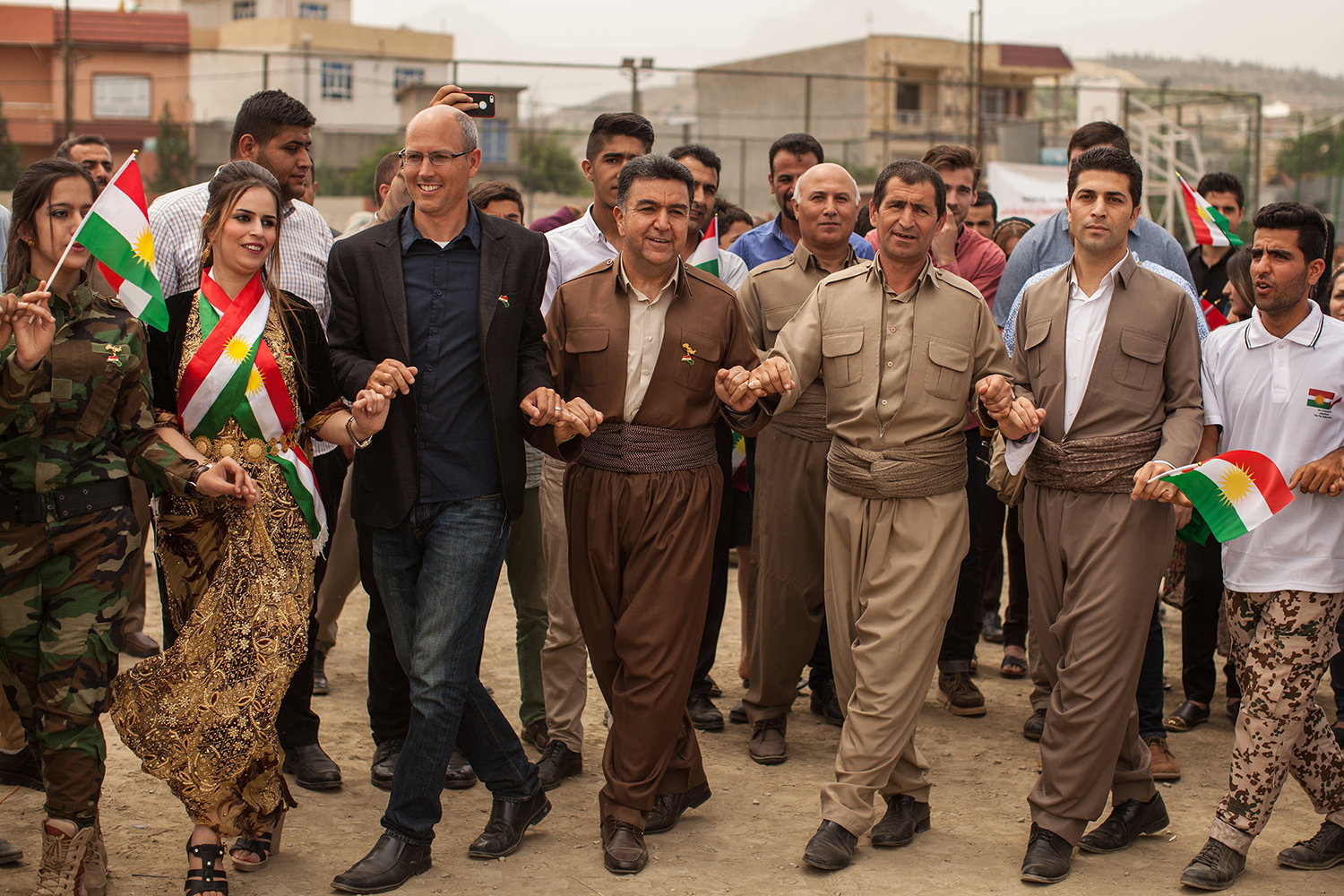 Country Director, Billy Ray, dances next to Mayor Kak Krmanj of Soran celebrating Kurdistan.