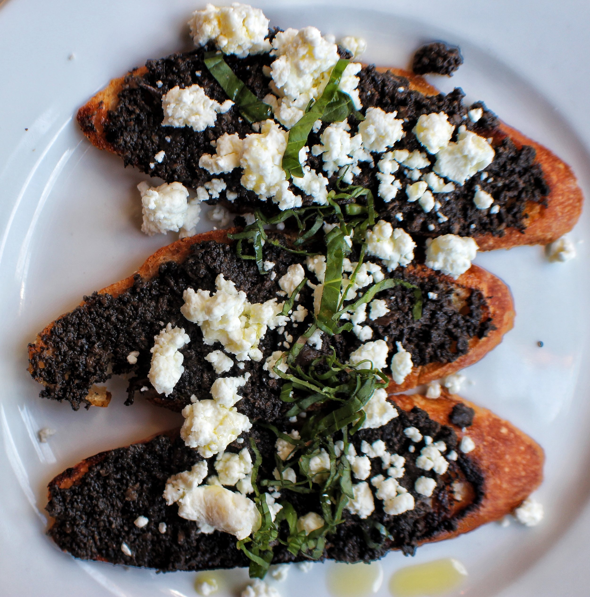 Truffle crostini - chunky truffle salsa topped with goat cheese