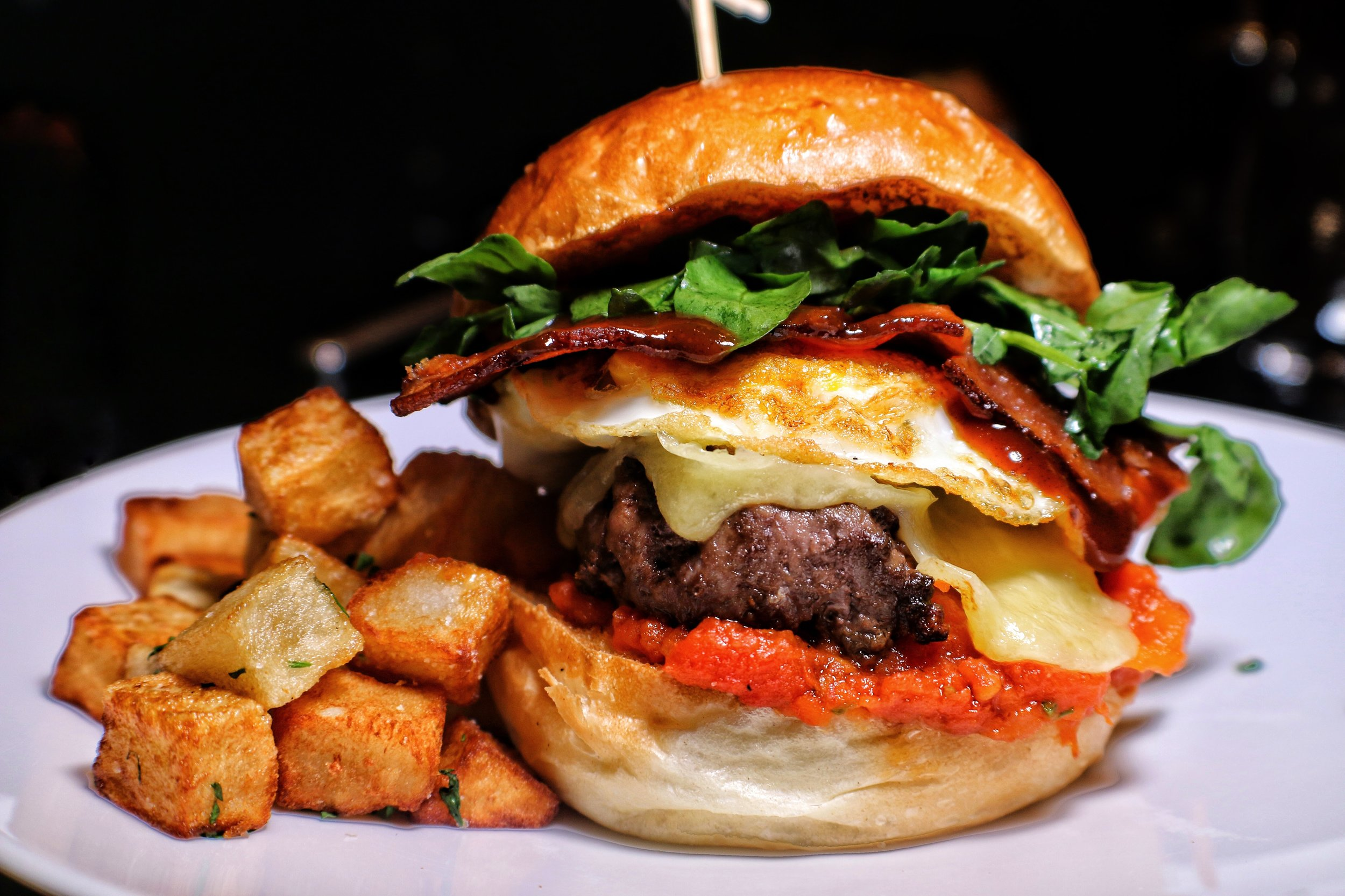 Brunch Burger, aged burger, brioche roll, fried egg, tomato jam, bacon