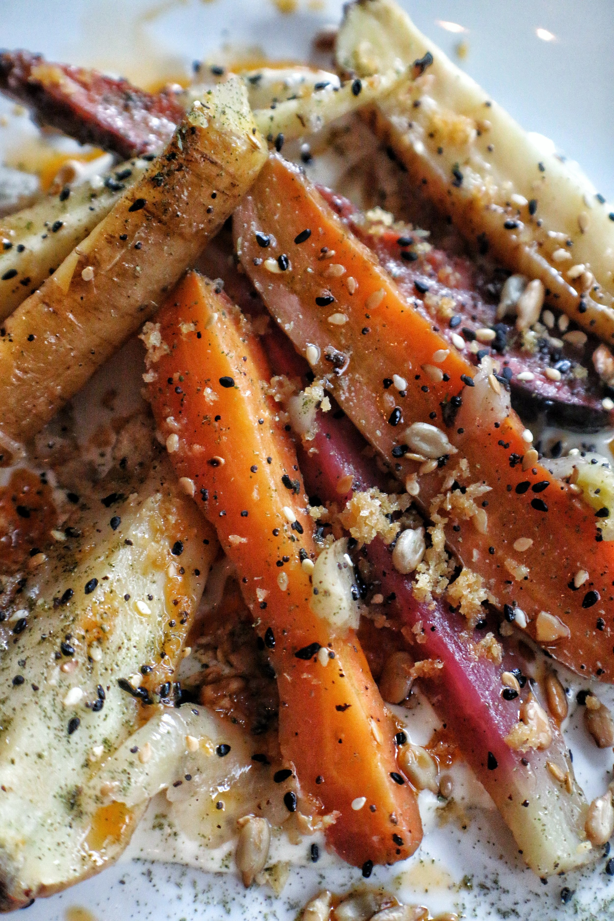 carrots, tahini cream, shallots, seeds, chili