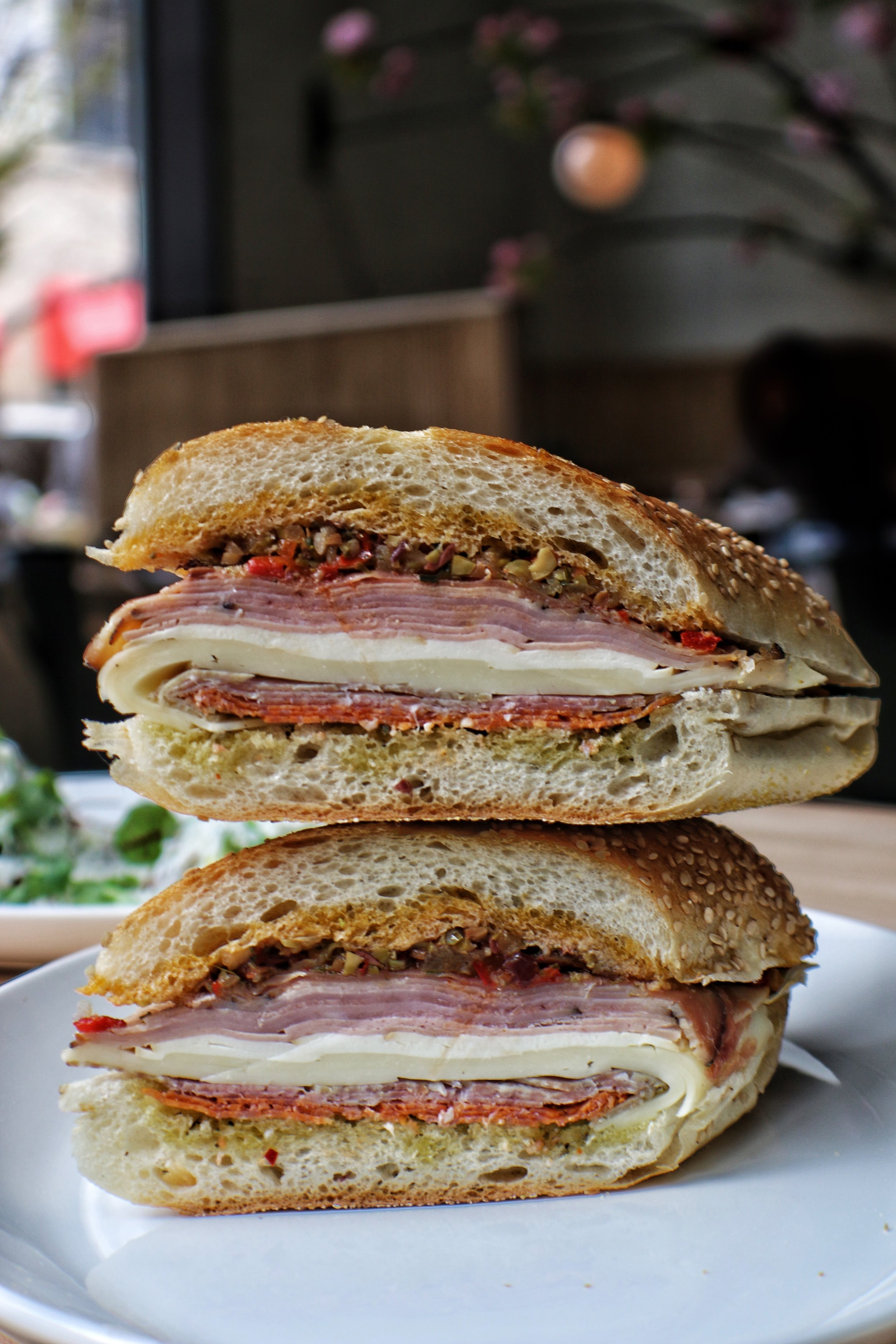 Matty's Muffaletta with Country Ham, Olive Salad & Smoked Di Palo's Mozzarella on a Sesame Hero