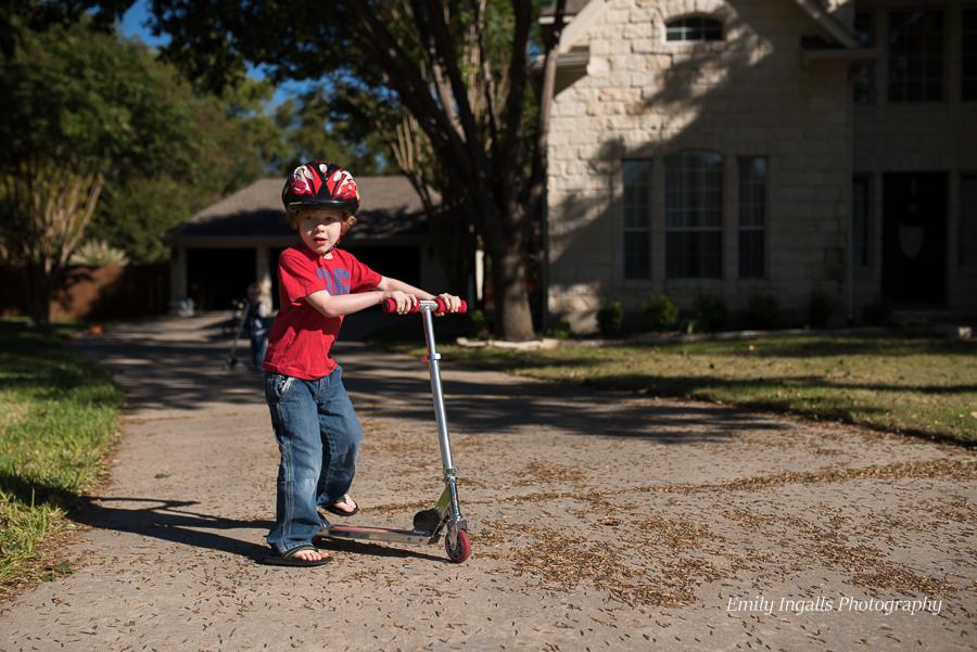 Scootering around on the driveway.