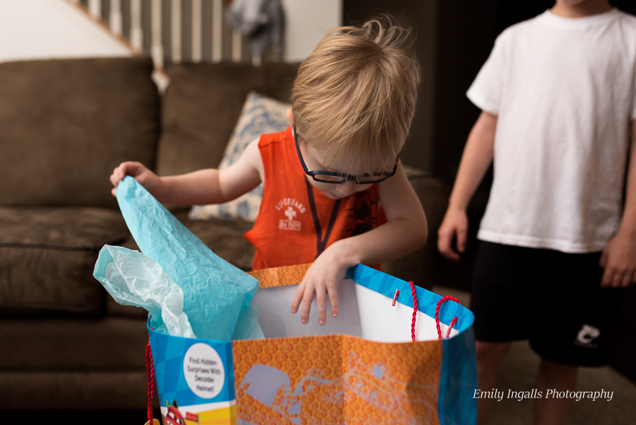 Opening presents (his older brother got to help again this year)
