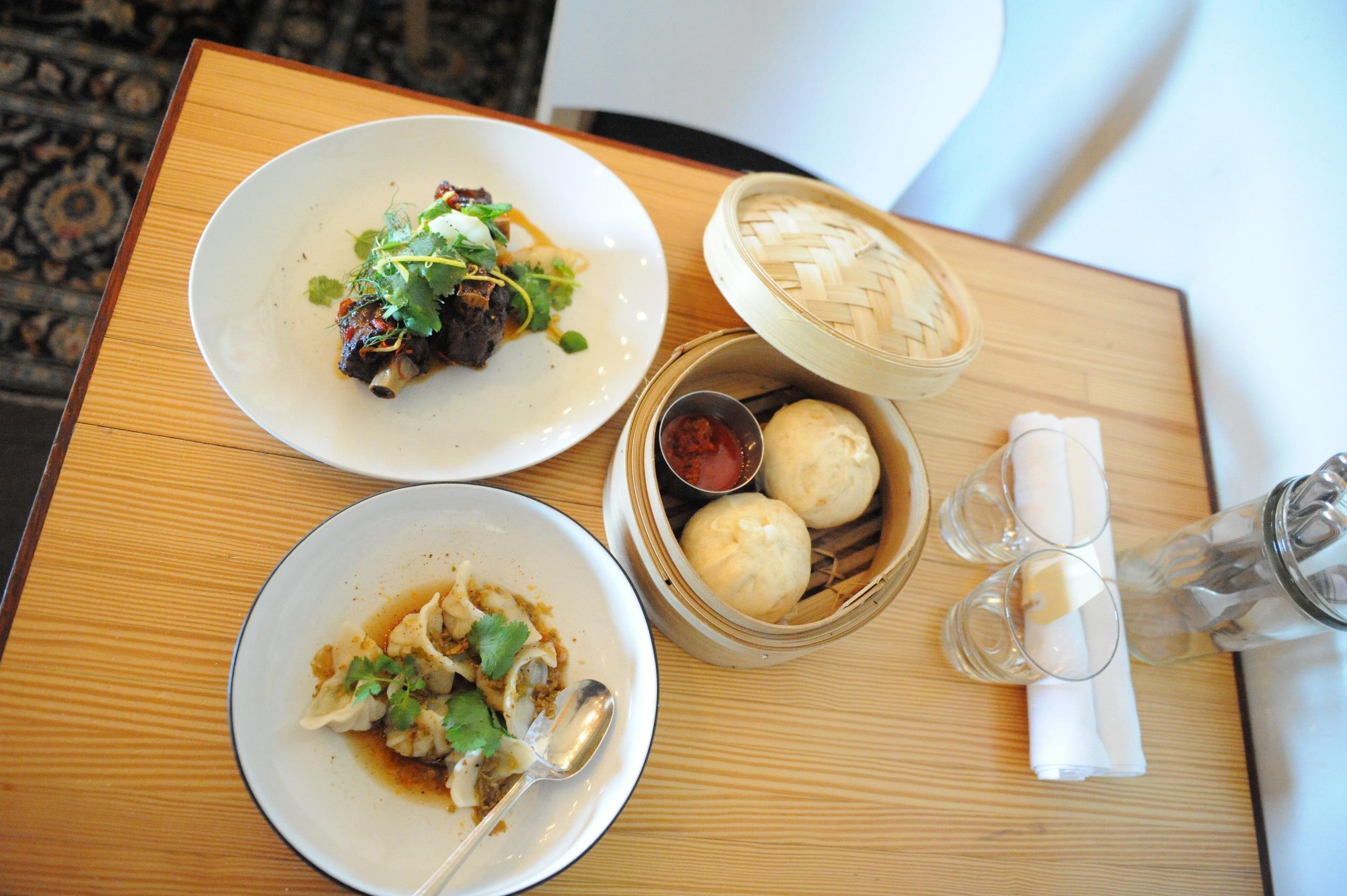 Entree selection of kangaroo tail, prawn dumplings and pork steam buns