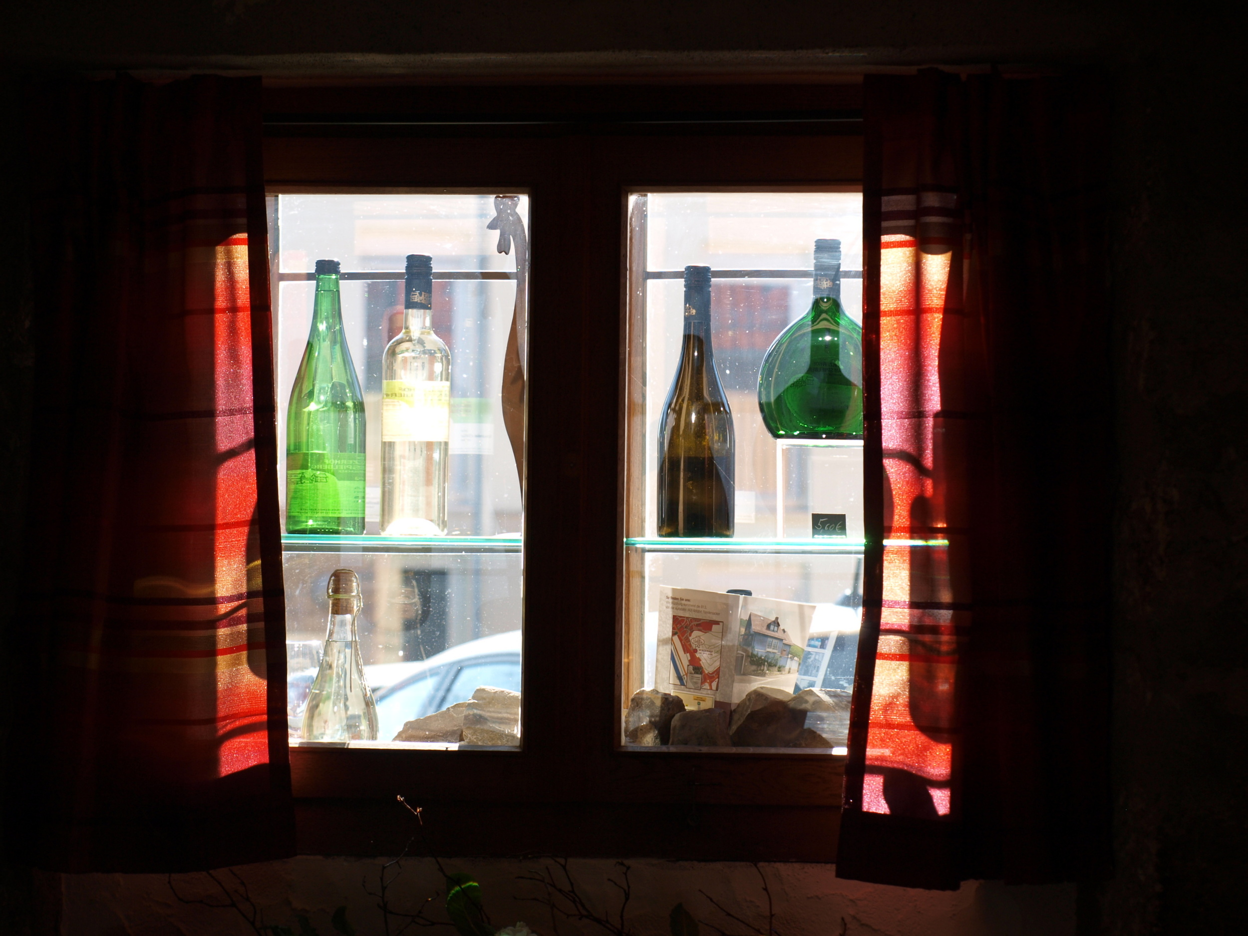 Randersacker-Seasonal wine tavern-window-looking out at the courtyard.jpg