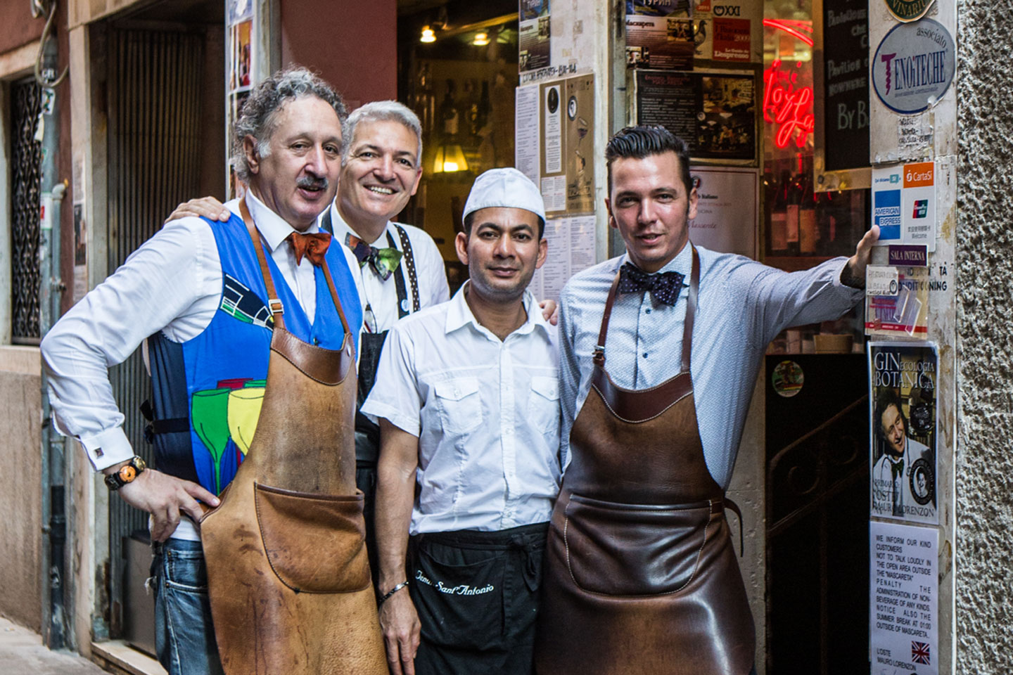 Lorenzon's colorful hand-painted bowtie and leather apron