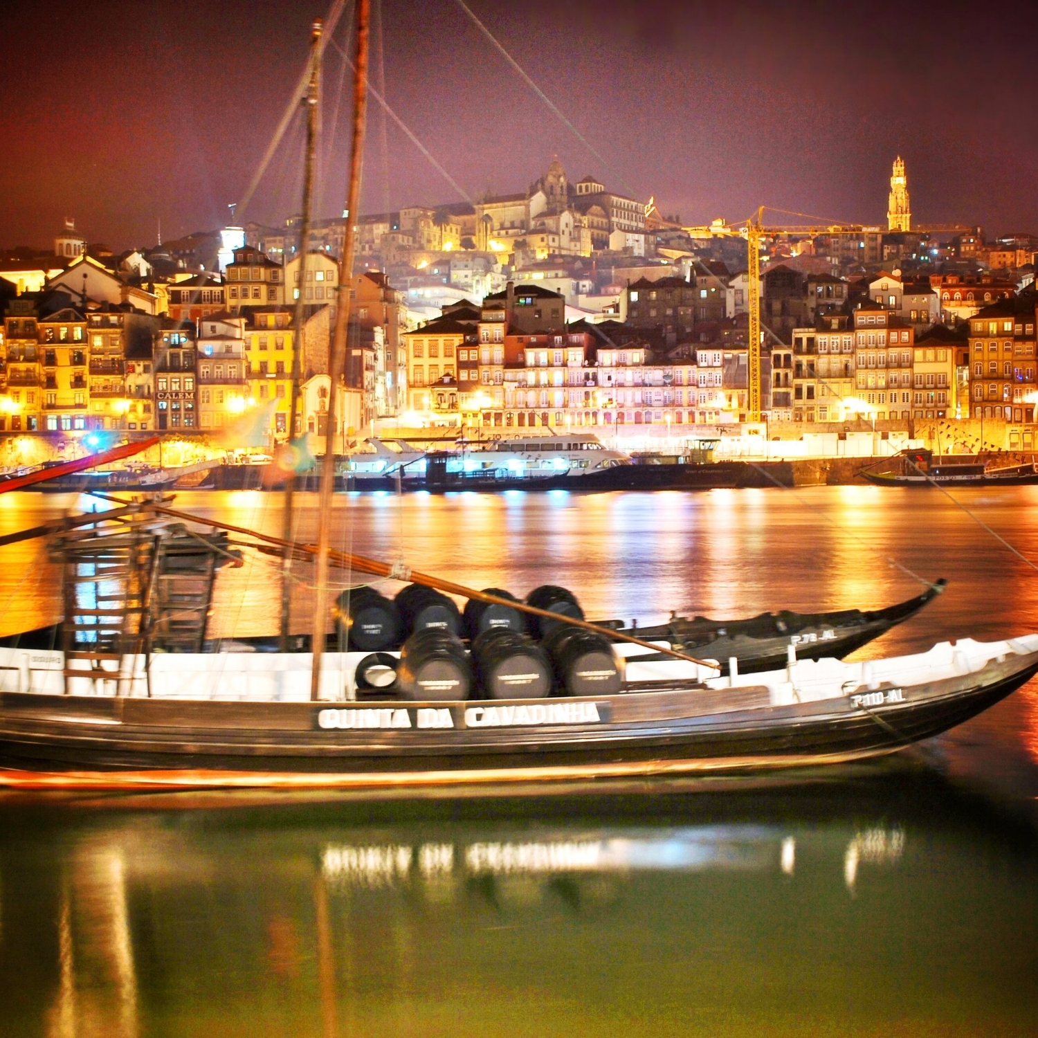 Rabelo boats in Porto at night. (Taken from the Gaia side of the river.) These boats have traditionally been used to move the port from the vineyards in the Duoro Valley to the cellers in Porto and Gaia, but now are more of a tourist attraction. (Photo Credit Greg Hudson)