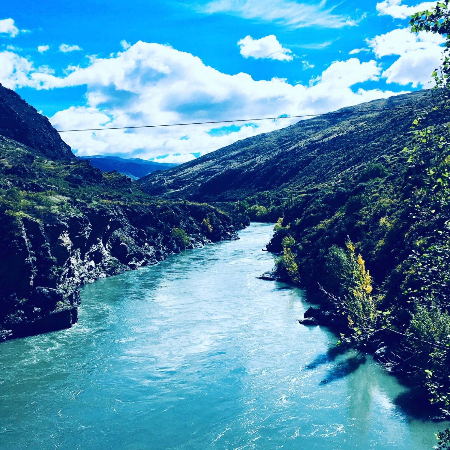 The Kawarau River, flowing beside Wild Earth Wines, located in Cromwell, Central Otago, NZ